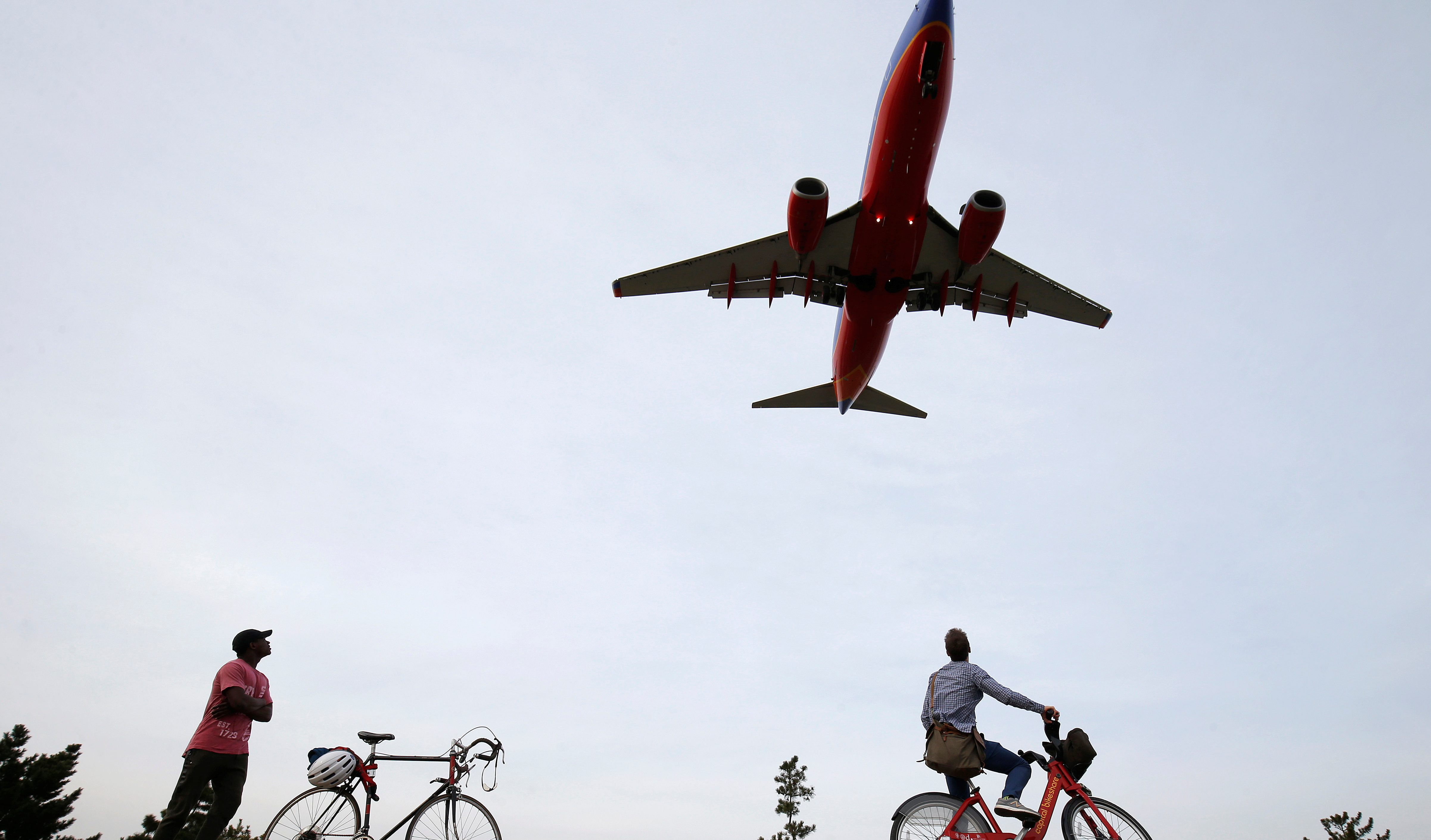 People watch airplanes land during unseasonably warm weather at Reagan National Airport in Washington, U.S., February 22, 2017.