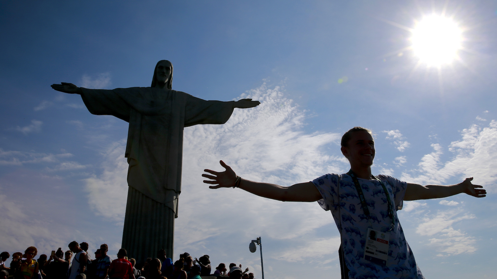 A tourist poses in front the Christ the Redeemer statue during the 2016 Summer Olympics in Rio de Janeiro, Brazil, Tuesday, Aug. 16, 2016. (AP Photo/Hassan Ammar)