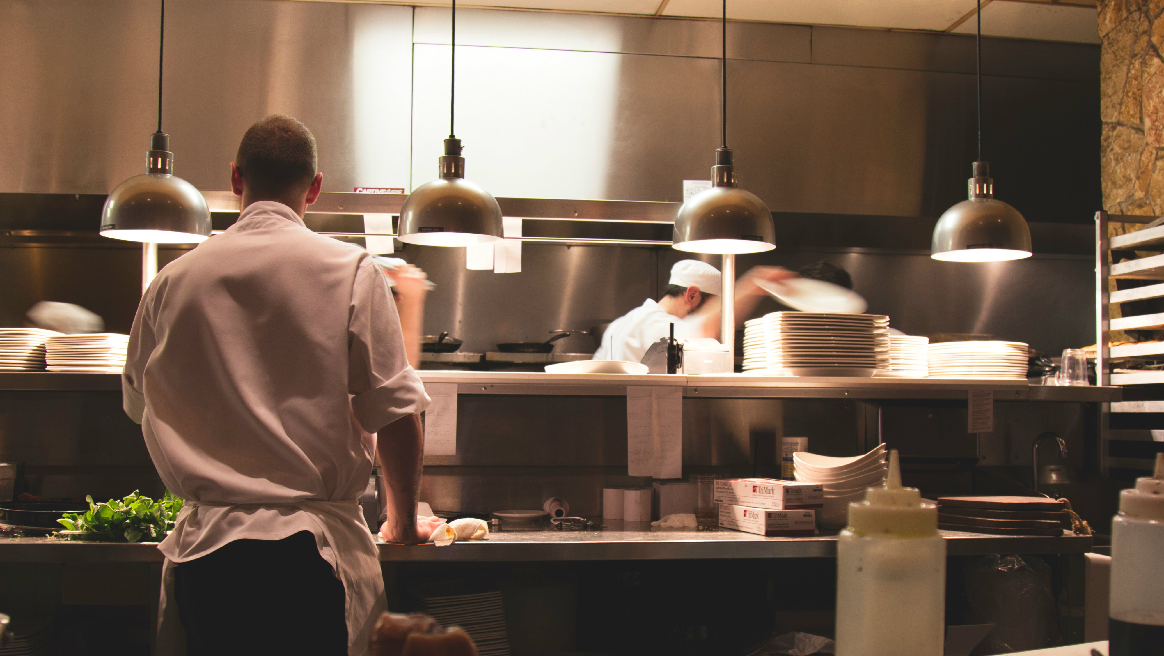 Workers in a kitchen.
