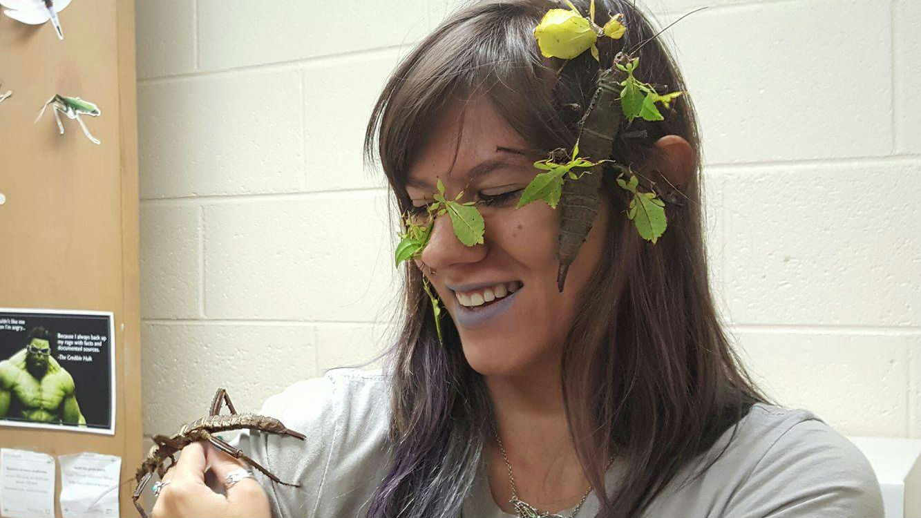 """Nancy Miorelli with a Thorny Devil and """"Leaf Insects"""" on her face."""