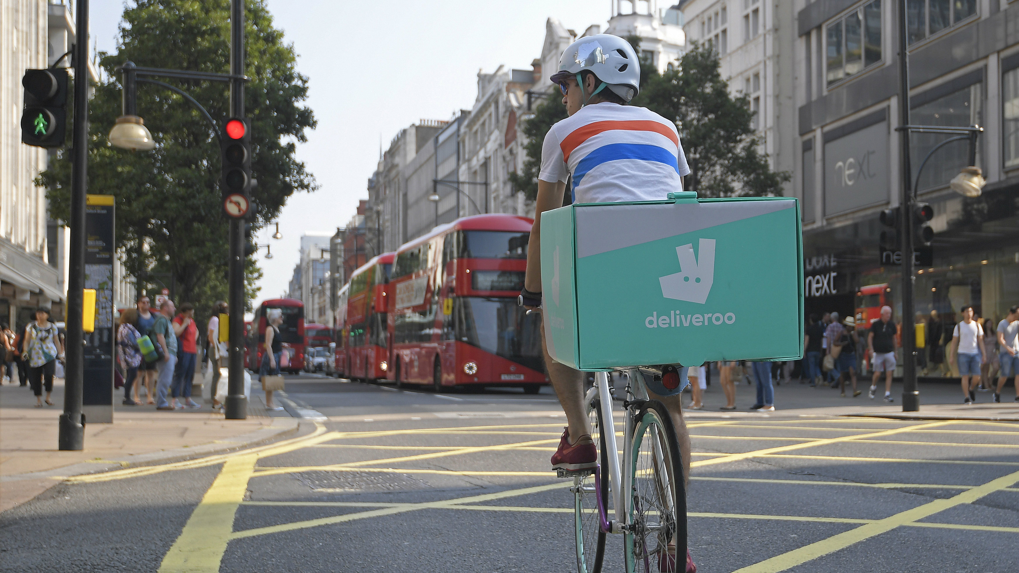 Deliveroo bike with rider in London, UK