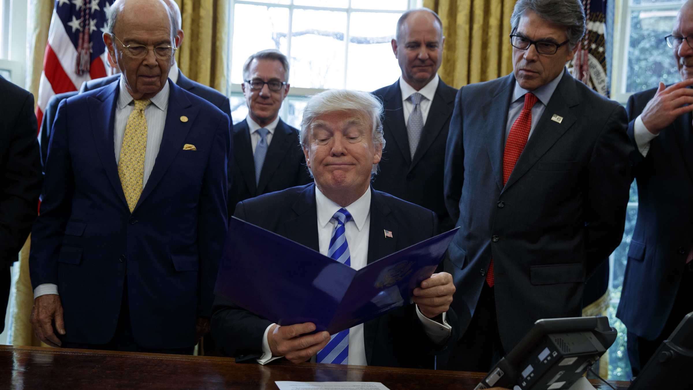 President Donald Trump announces the approval of a permit Friday to build the Keystone XL pipeline, clearing the way for the $8 billion project, in the Oval Office of the White House, Friday, March 24, 2017, in Washington.