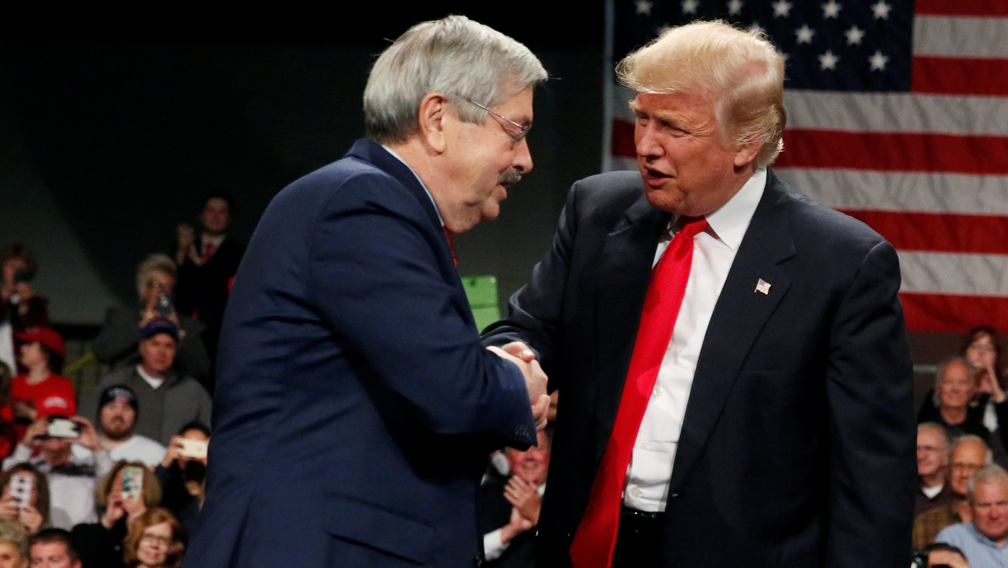 U.S. President-elect Donald Trump shakes hands with Governor of Iowa Terry Branstad (L) at the USA Thank You Tour event at the Iowa Events Center in Des Moines, Iowa, U.S., December 8, 2016.