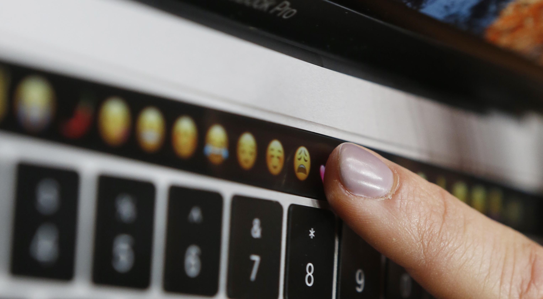 finger points at emoji keyboard