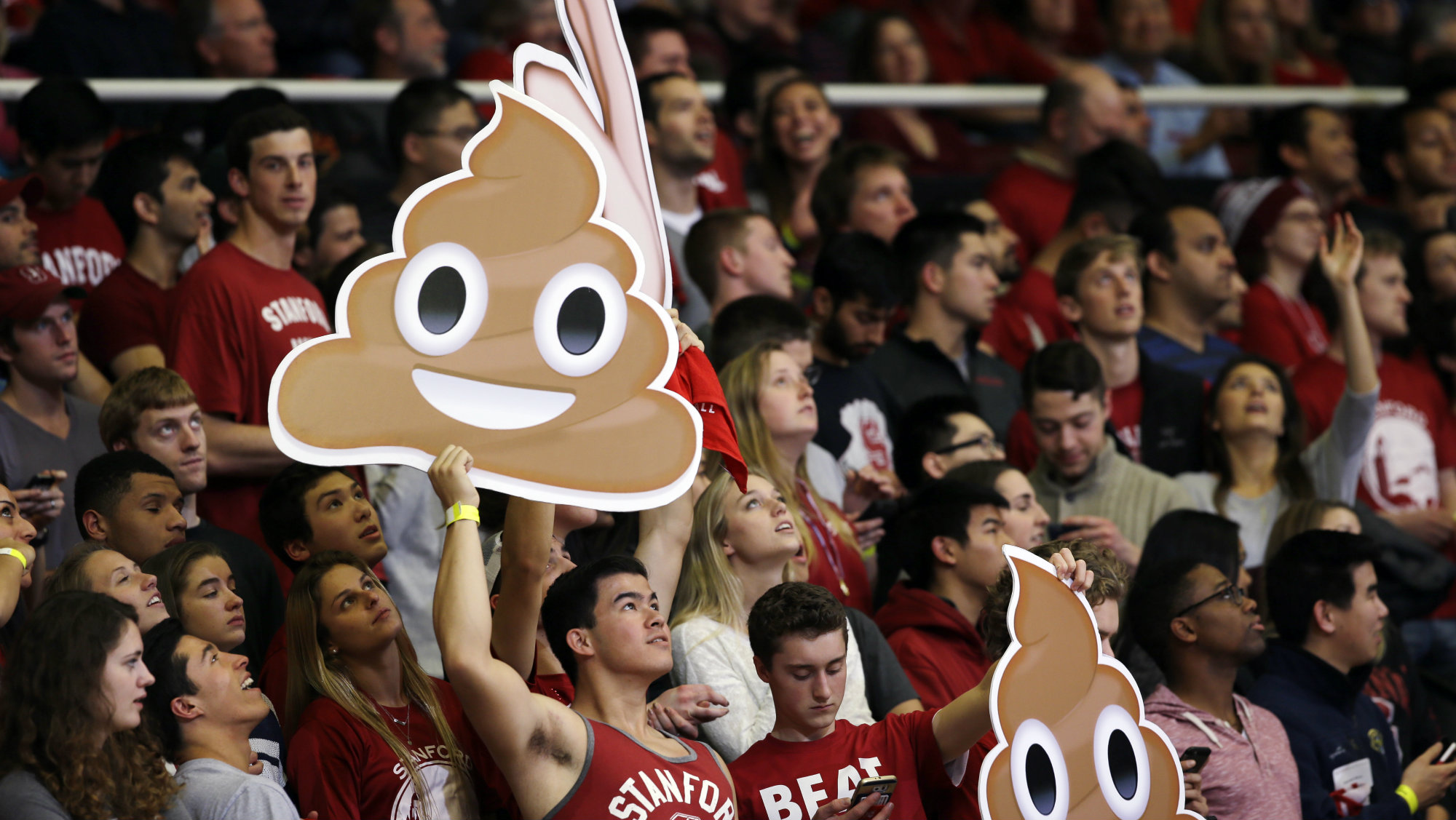 Fans hold emojis during the first half of an NCAA college basketball game between Stanford and California Thursday, Jan. 14, 2016, in Stanford, Calif.