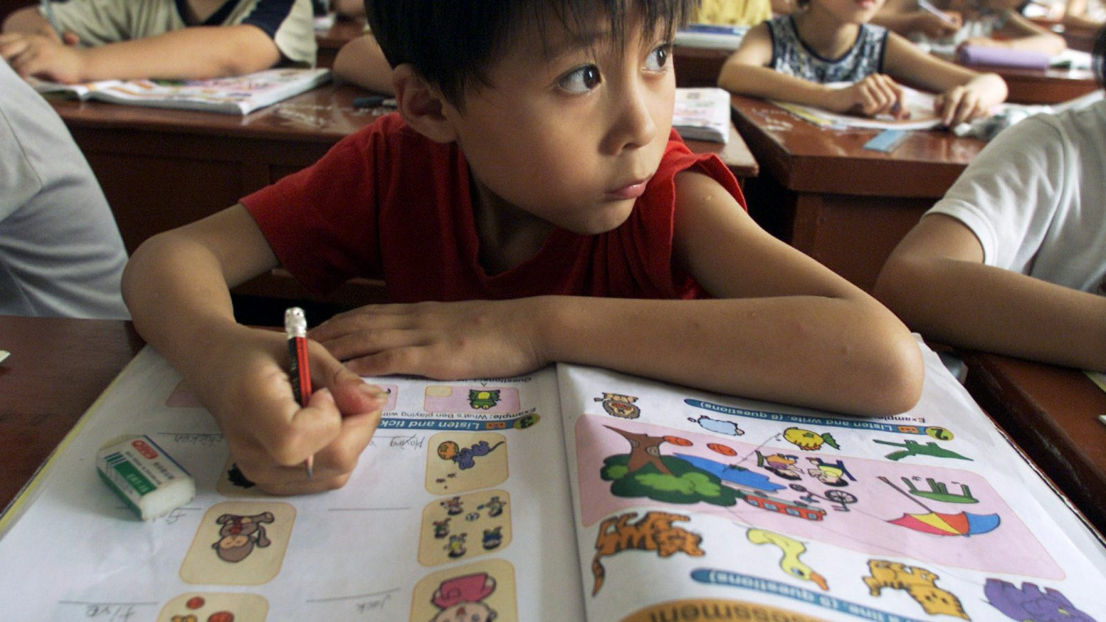 - PHOTO TAKEN 12JUL02 - Nine-year-old Chinese pupil, Sun Minyi, listens to his teacher during a special English class at Chongming county, north of Shanghai July 12, 2002. Learning English has become increasingly popular among Chinese after China progressively opens up to the outside world. More grade school pupils, college students, professionals and even taxi drivers are now studying the language.  Pictures taken July 12, 2002. - RTXLELE