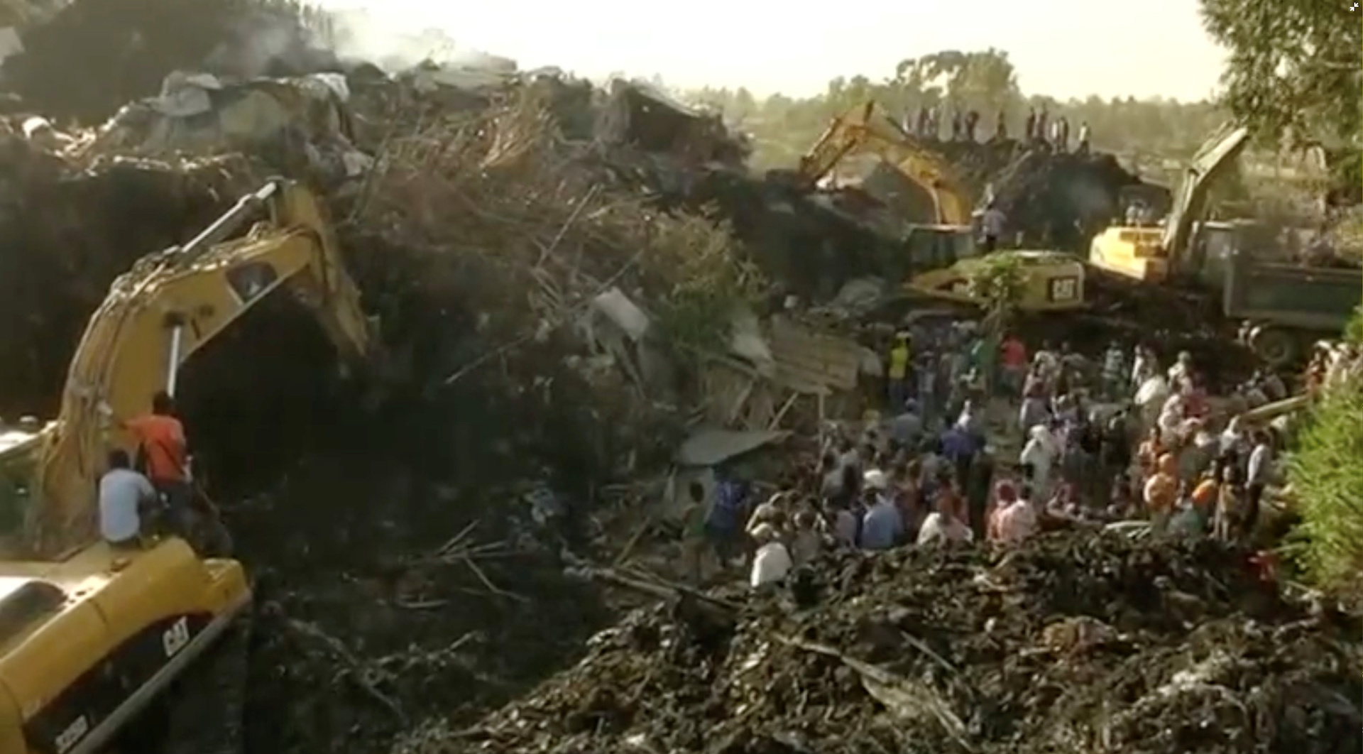 Excavators work after a landslide at a garbage dump on the outskirts of Addis Ababa, Ethiopia in this still image taken from a video from March 12, 2017.