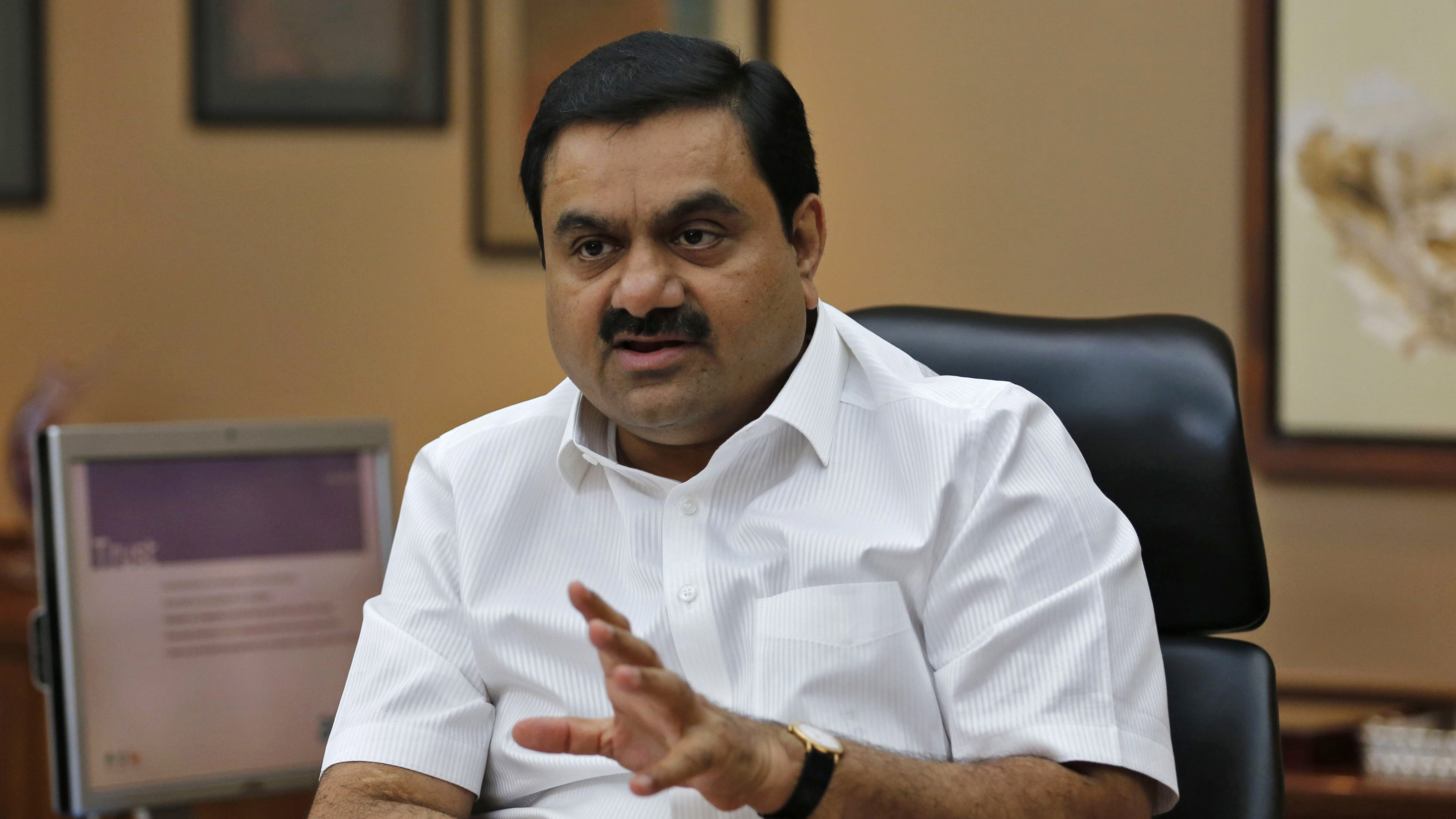 Indian billionaire Gautam Adani speaks during an interview with Reuters at his office in the western Indian city of Ahmedabad April 2, 2014. The way billionaire Indian infrastructure-builder Adani sees it, working with the government does not make him a crony-capitalist. Adani's rapid ascent to the top tier of Indian business is often associated with the rise of Narendra Modi, the Hindu nationalist opposition leader widely expected to become India's next prime minister once the country's election ends next month. Its flagship Adani Enterprises soared 22.9 percent for its biggest daily gain on Thursday and has nearly doubled since the start of February, compared with a nearly 20 percent gain in the infrastructure index.The way billionaire Indian infrastructure-builder Gautam Adani sees it, working with the government does not make him a crony-capitalist. Adani's rapid ascent to the top tier of Indian business is often associated with the rise of Narendra Modi, the Hindu nationalist opposition leader widely expected to become India's next prime minister once the country's election ends next month. Its flagship Adani Enterprises soared 22.9 percent for its biggest daily gain on Thursday and has nearly doubled since the start of February, compared with a nearly 20 percent gain in the infrastructure index. Picture taken April 2, 2014. REUTERS/Amit Dave (INDIA - Tags: ENERGY BUSINESS) - RTR3KP86