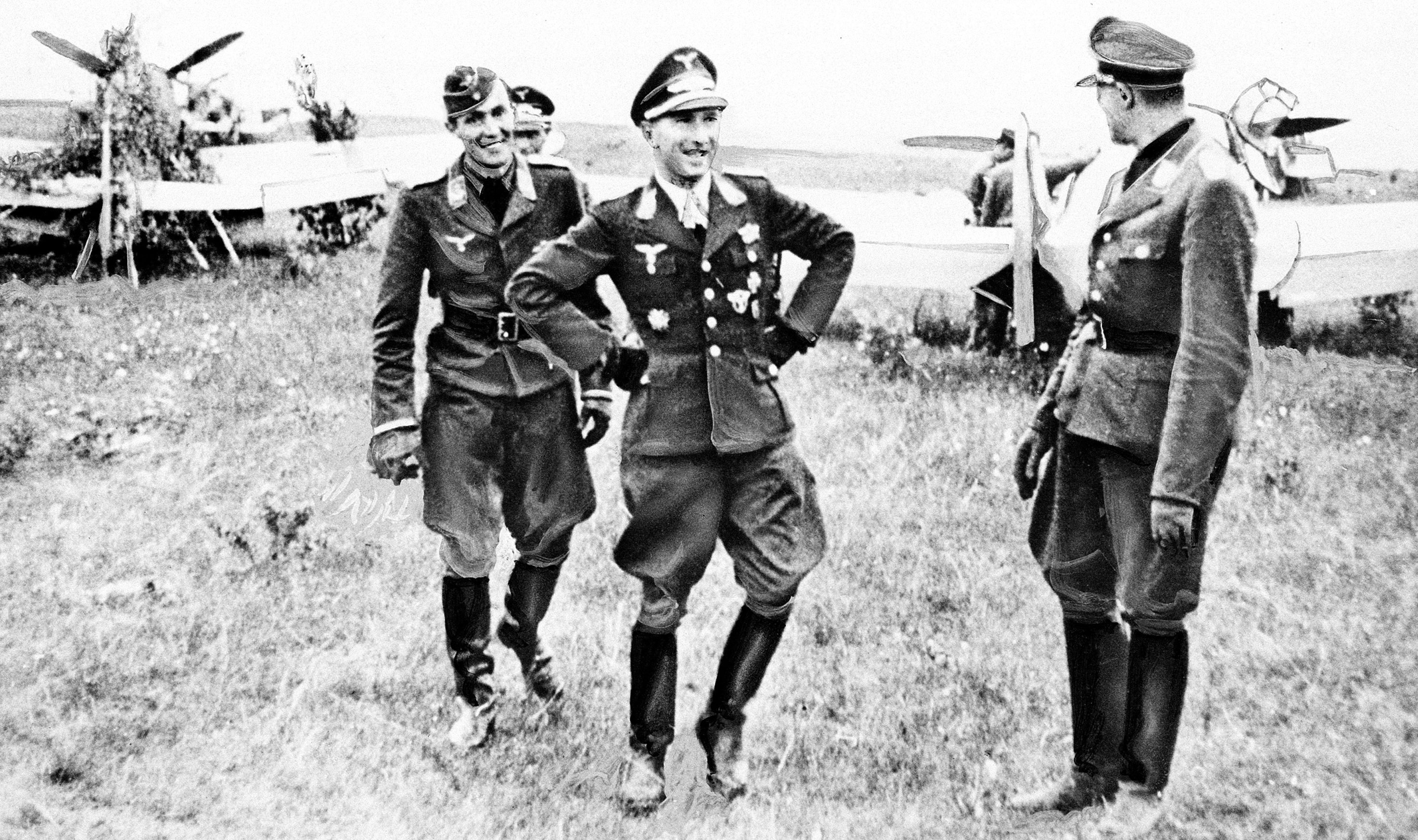 Lt. Col. Werner Moelders, center, highest-ranking ace of the German Luftwaffe and credited with having downed 101 enemy planes, shares a laugh with unidentified comrades as he appears on an air field at the Eastern Front, on August 30, 1941.