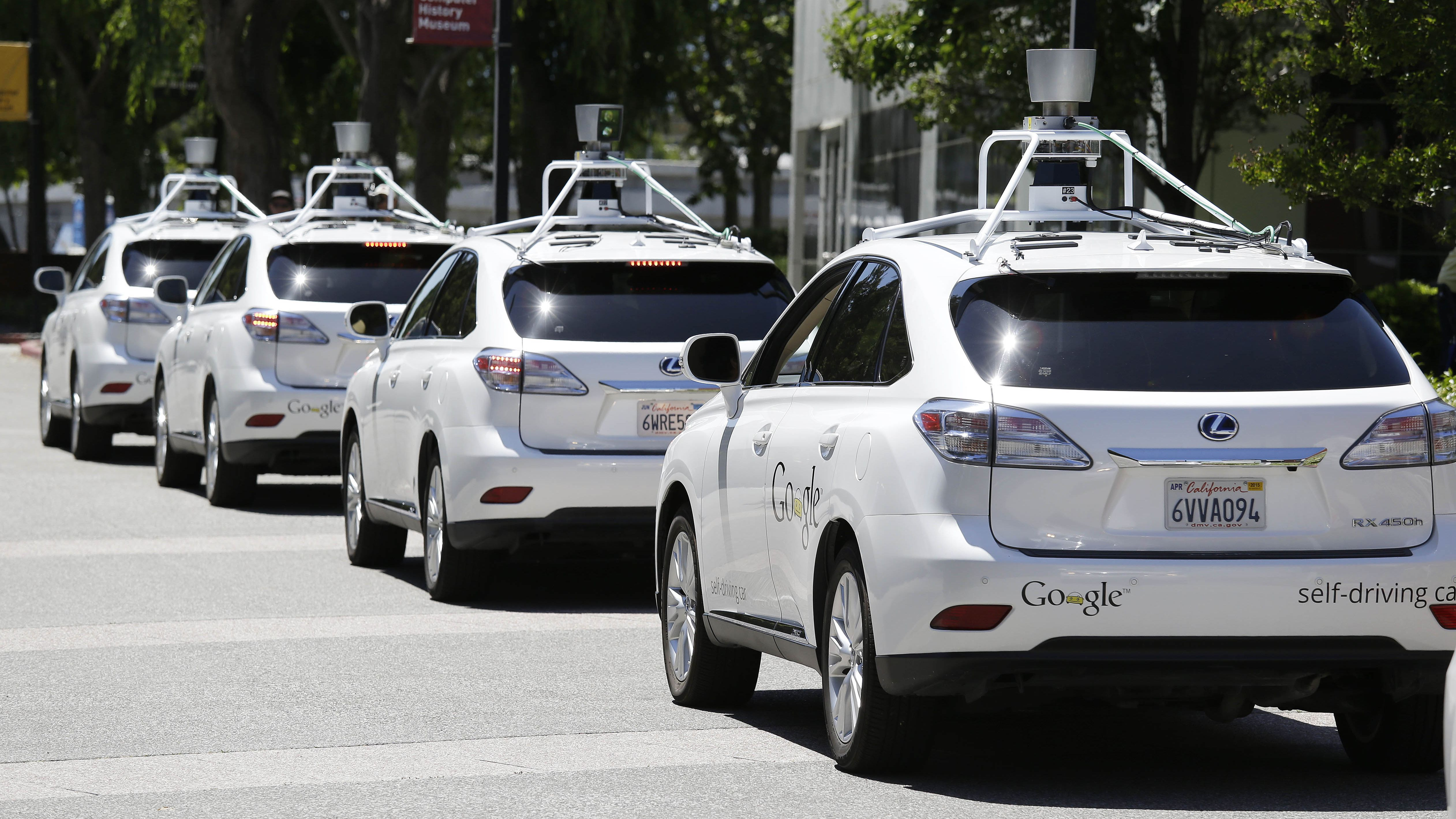 In this photo taken Wednesday, May 14, 2014, a row of Google self-driving cars are shown outside the Computer History Museum in Mountain View, Calif. Four years ago, the Google team developing cars which can drive themselves became convinced that, sooner than later, the technology would be ready for the masses. There was just one problem: Driverless cars almost certainly were illegal.(AP Photo/Eric Risberg)
