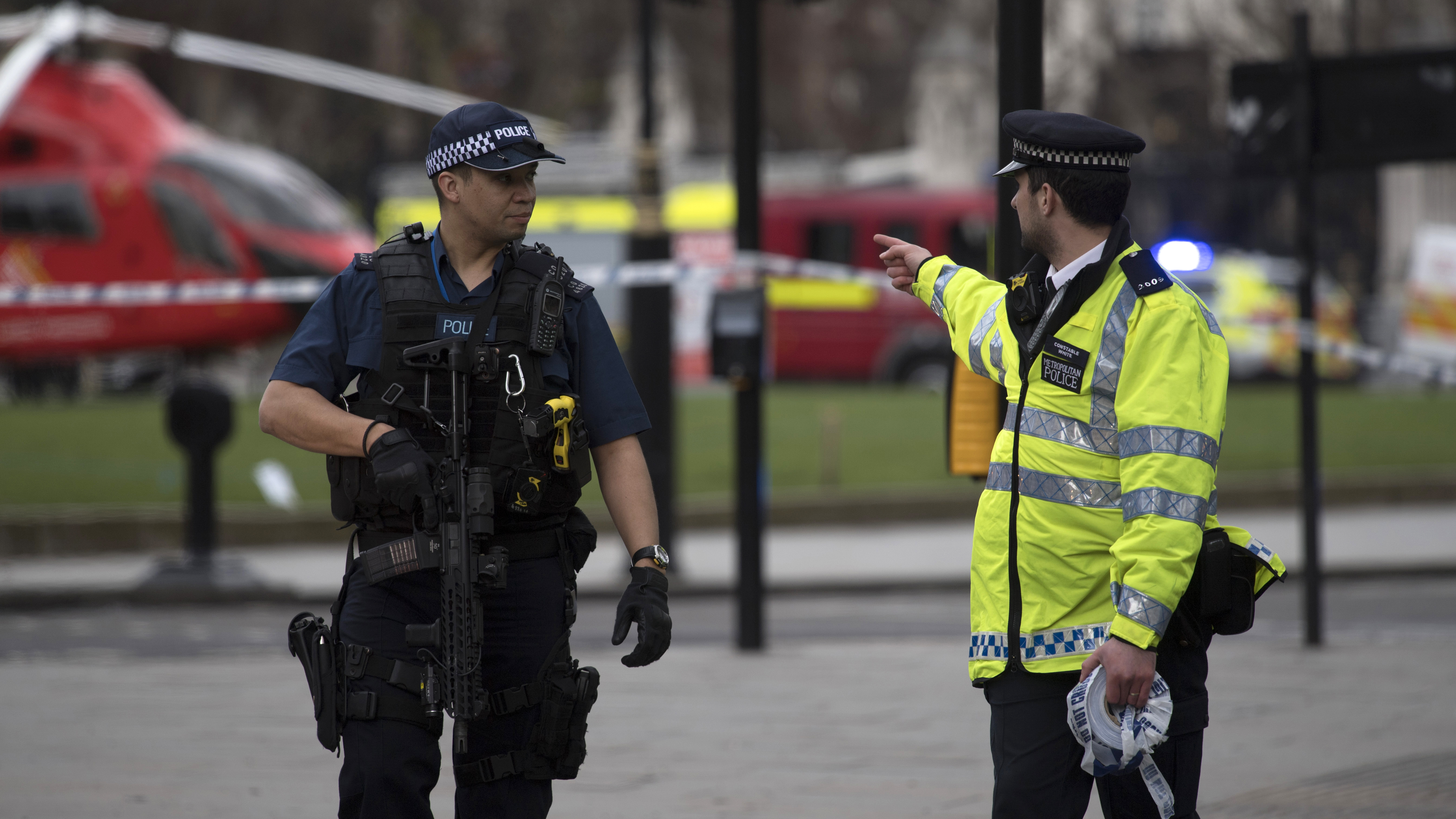 epa05863954 Armed police following major incidents outside the Houses of Parliament in central London, Britain, 22 March 2017. Scotland Yard said on 22 March 21017 the police were called to a firearms incident in the Westminister palace grounds and on Westminster Bridge amid reports of at least people killed and several other people injured in central London.  EPA/WILL OLIVER