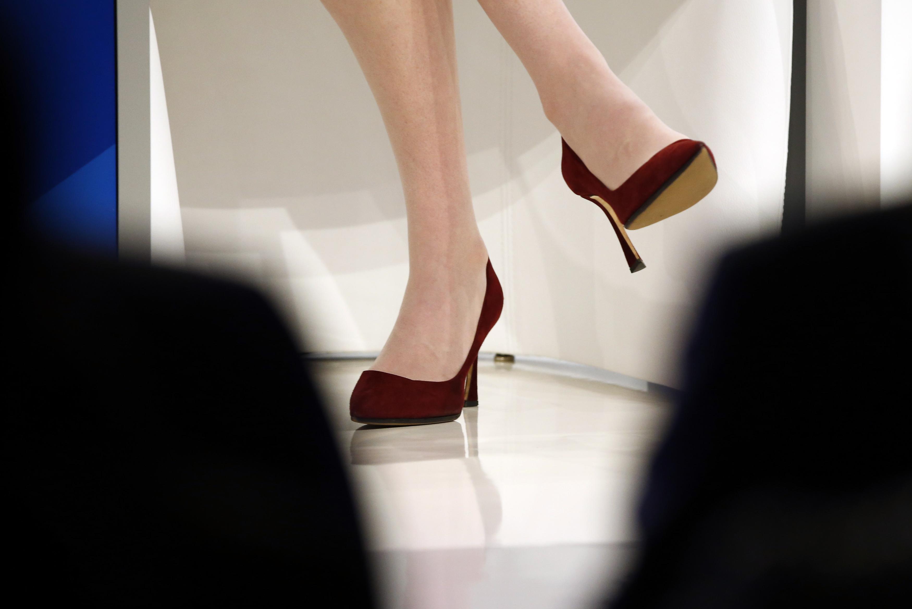 high heels and legs under a desk