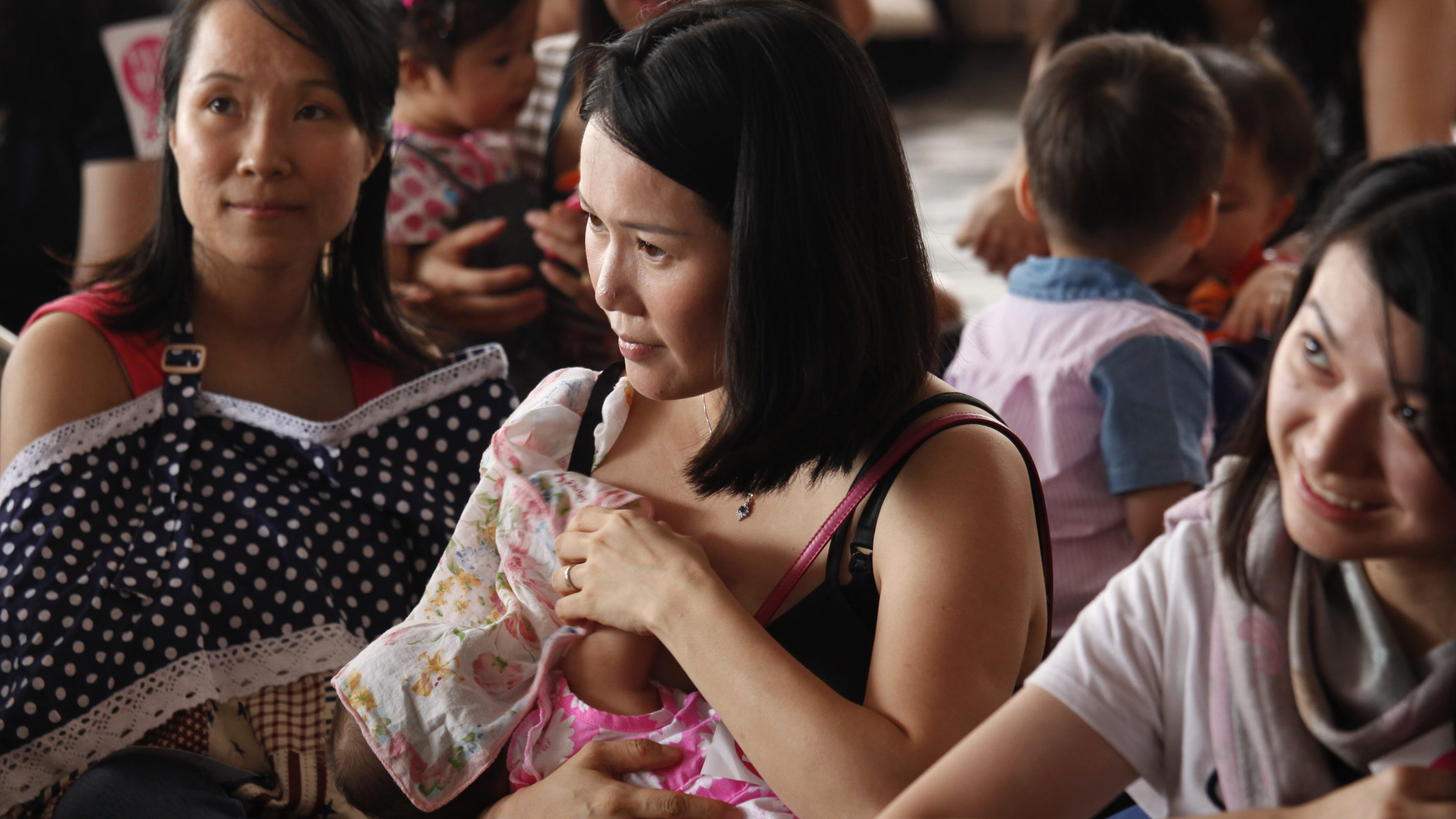 Mothers breastfeed their children during a breastfeeding flash mob demonstration at a public place in Hong Kong June 14, 2014. The group urged the government to establish a breastfeeding policy to protect the rights of nursing mothers, the organizer said in a press release.