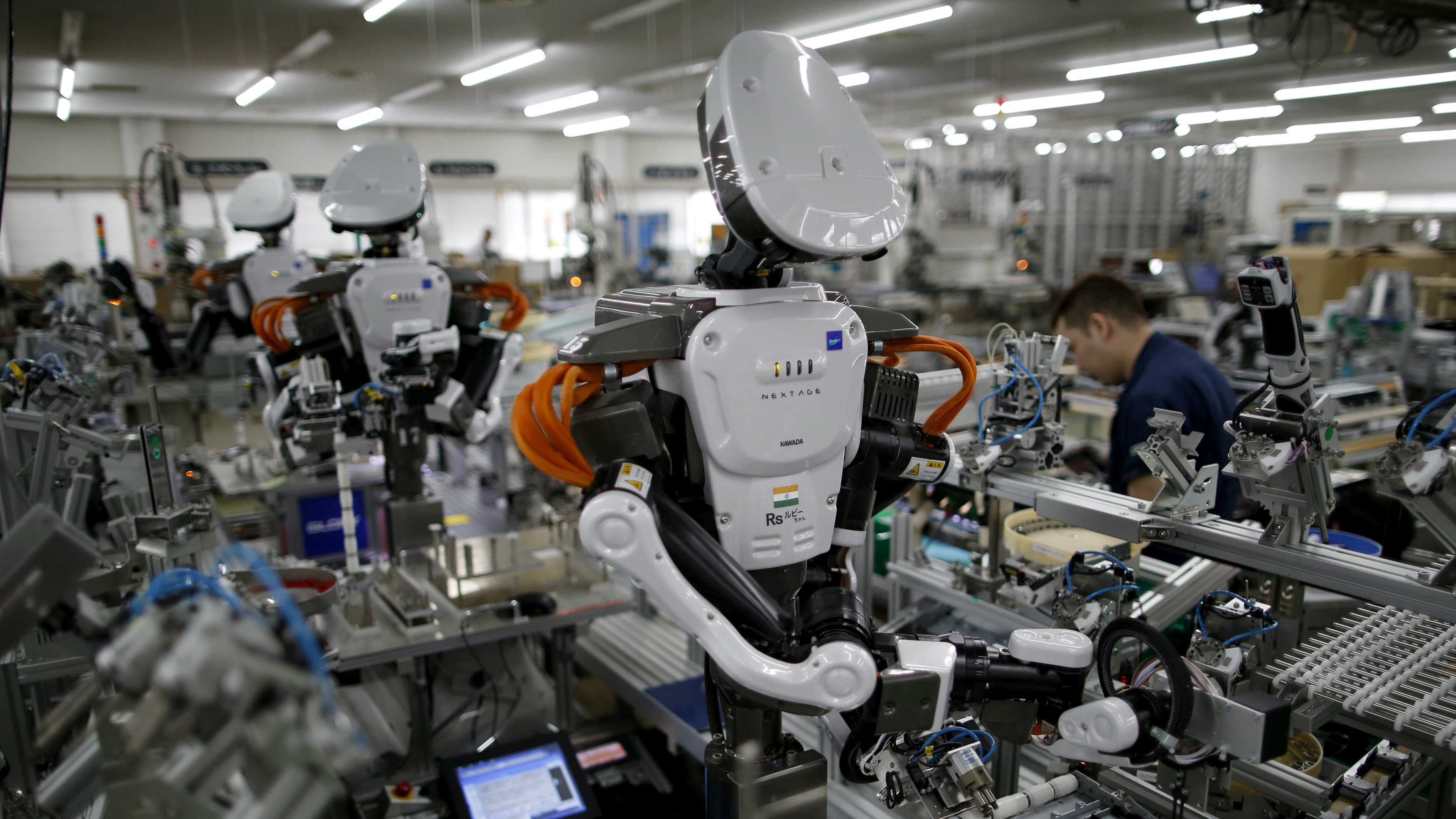 A humanoid robot working in a factory.