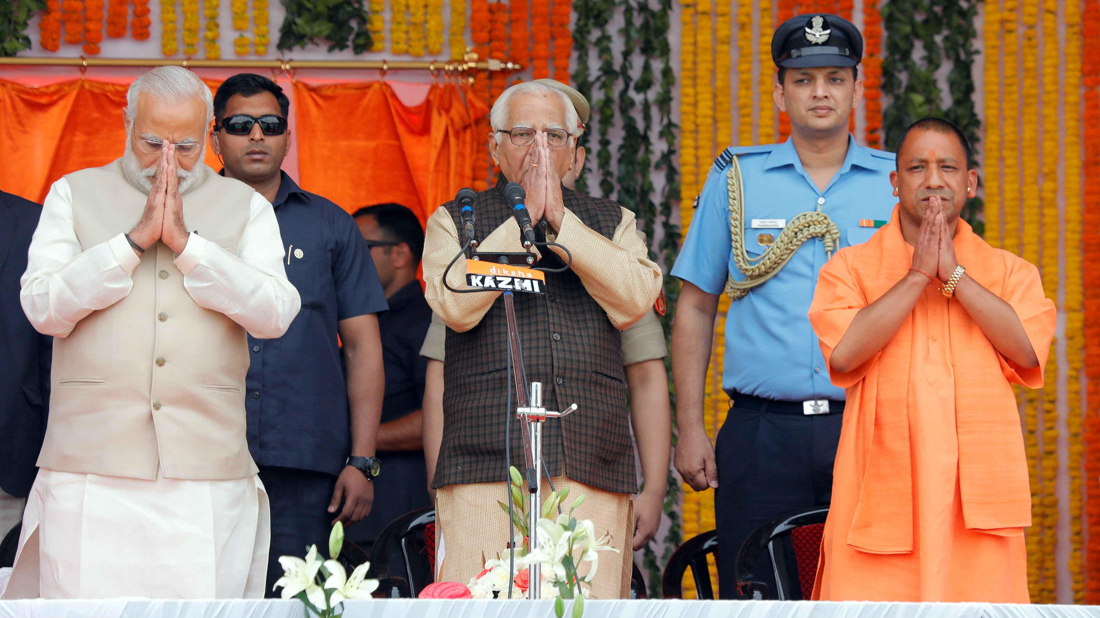 Prime Minister Narendra Modi (L), Uttar Pradesh governor Ram Naik (C) and India's ruling Bharatiya Janata Party (BJP) leader Yogi Adityanath (R) greet a gathering before Adityanath takes an oath as the new Chief Minister of India's most populous state of Uttar Pradesh during a swearing-in ceremony in Lucknow, India, March 19, 2017.