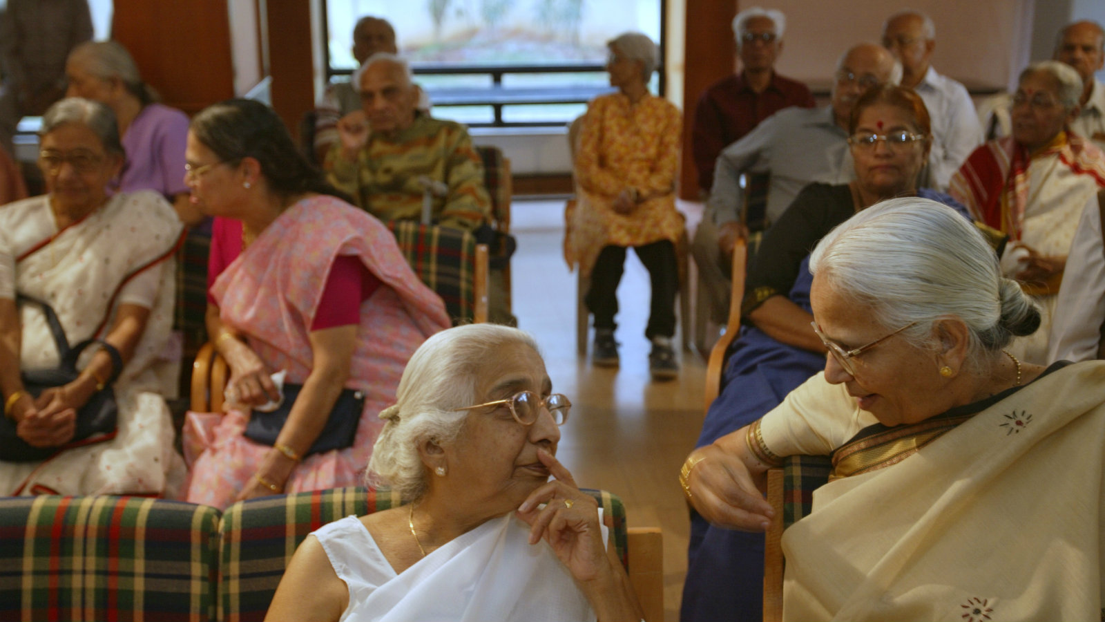 Residents of Athashri, a housing complex for senior citizens, interact in the community hall before a monthly meeting, in Pune, India, on Feb. 12, 2008. A cultural revolution is under way in India, led by an unlikely gray-haired vanguard that is dramatically changing what it means to be old here, and what it means to be a family. In a country where family is society's strongest cultural pillar, the thought of the elderly living alone has long been anathema, but many old people today are embracing the notion.