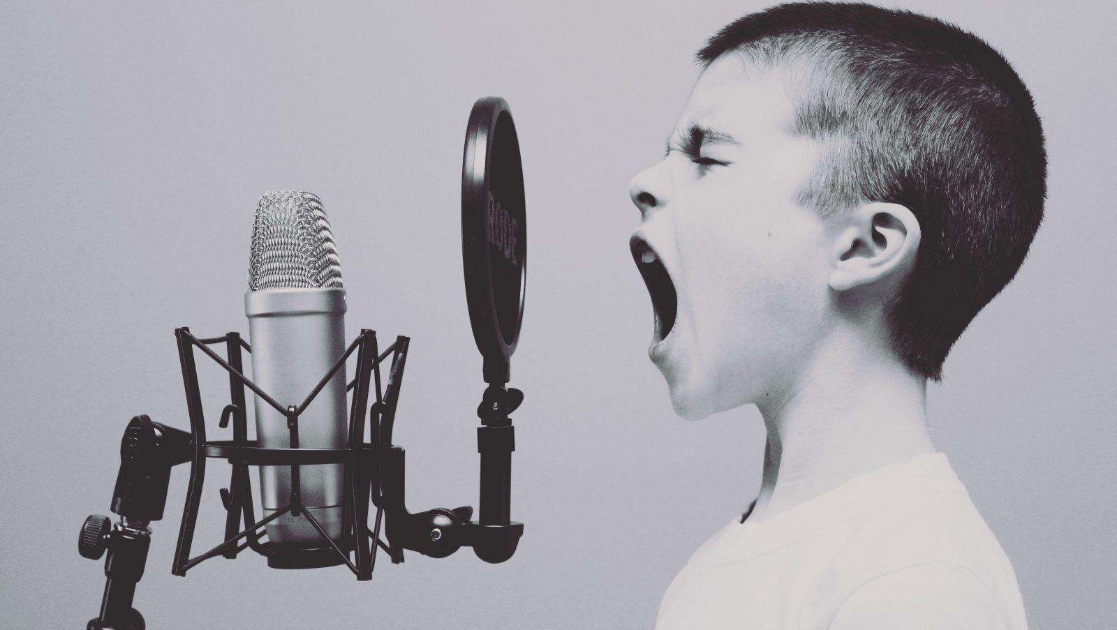 Kid screams into microphone