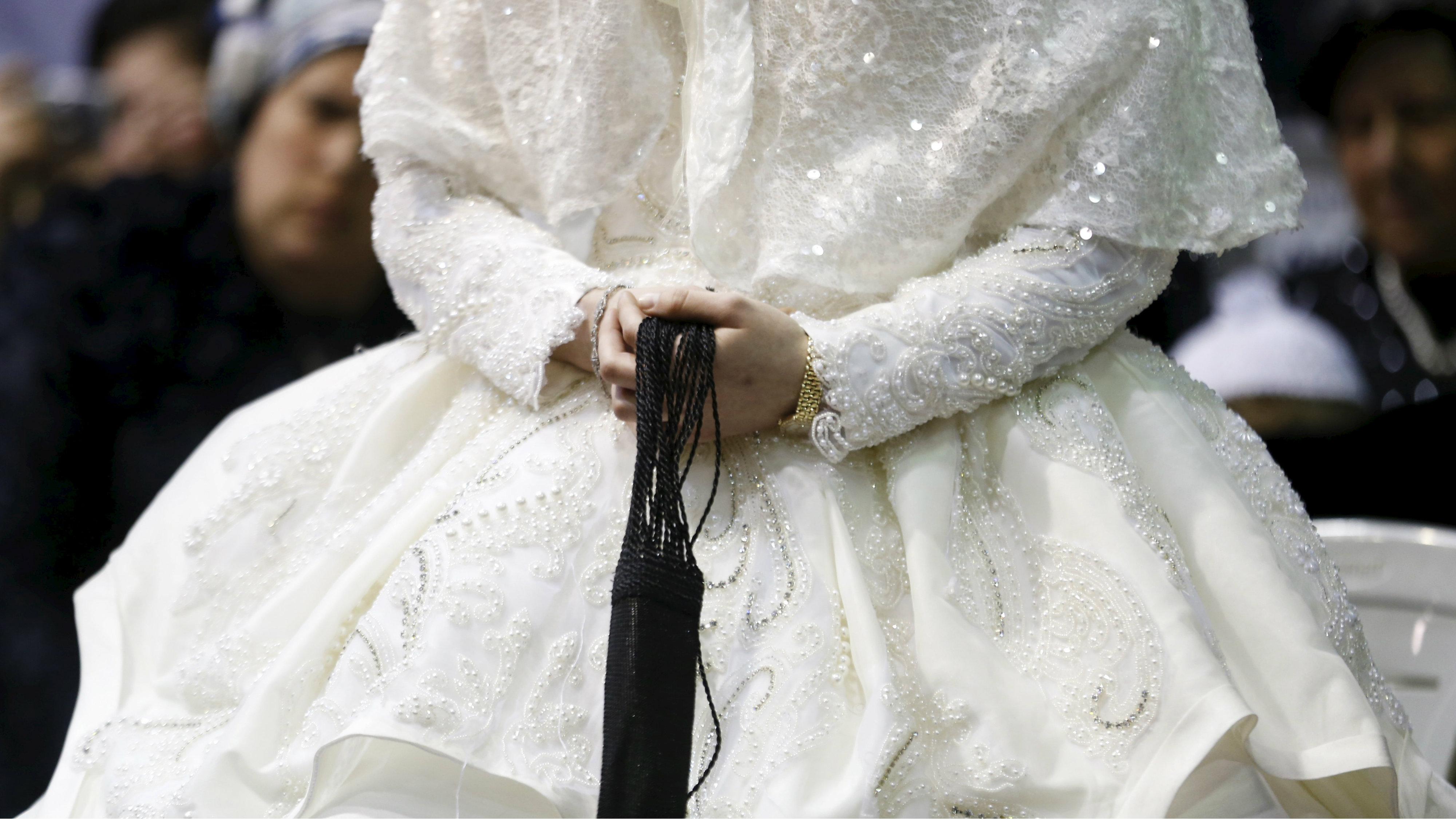 "An ultra-Orthodox Jewish bride takes part in the ""mitzva tantz"""