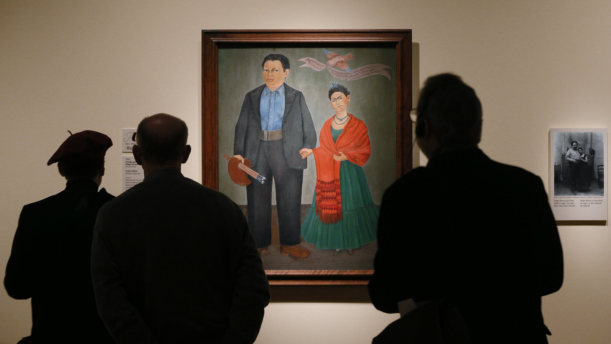 "Visitors view Frida Kahlo's 1931 painting ""Frieda and Diego Rivera"" in a new exhibition titled ""Diego Rivera and Frida Kahlo in Detroit"" at the Detroit Institute of Arts in Detroit Tuesday, March 10, 2015."