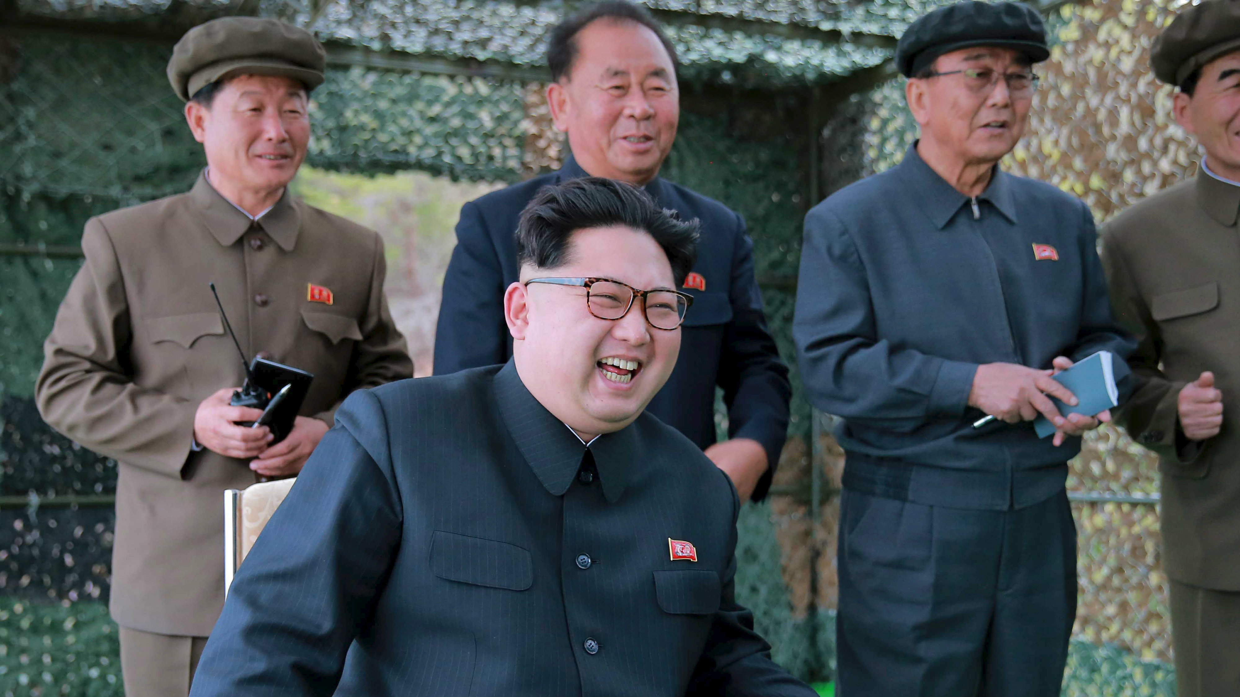North Korean leader Kim Jong Un guides on the spot the underwater test-fire of strategic submarine ballistic missile