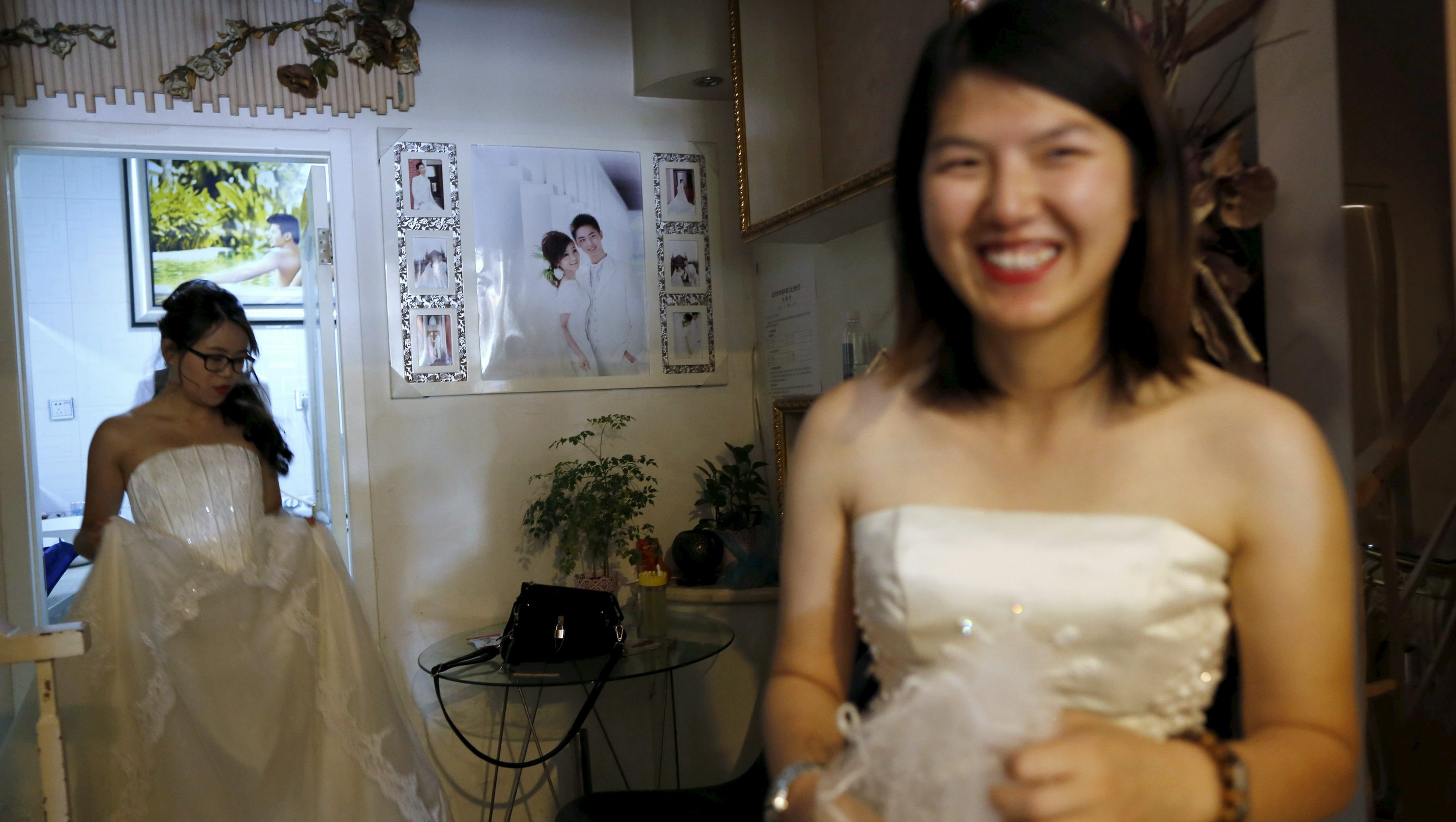 Li Tingting (R) smiles as she waits for her partner Teresa at a bridal photography studio while meeting the media in Beijing, China July 2, 2015. Li, a 25-year-old prominent women's rights activist who was released from detention in April, held a wedding ceremony with her partner Teresa on Thursday and announced their marriage in an effort to push for LGBT (lesbian, gay, bisexual, and transgender) rights in China.