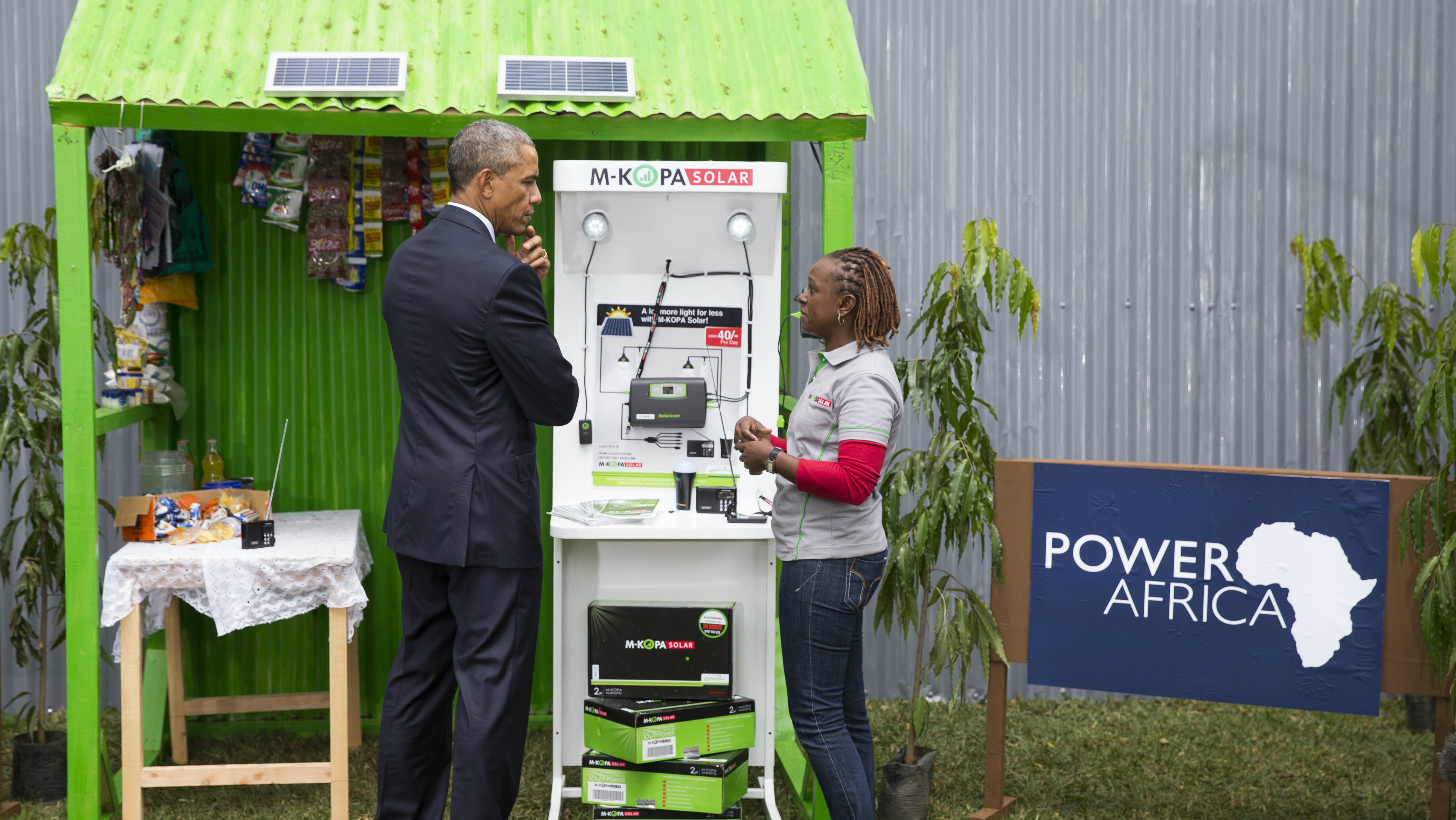 President Barack Obama looks at a solar power exhibit during a tour of the Power Africa Innovation Fair, Saturday, July 25, 2015, in Nairobi. Obama's visit to Kenya is focused on trade and economic issues, as well as security and counterterrorism cooperation.