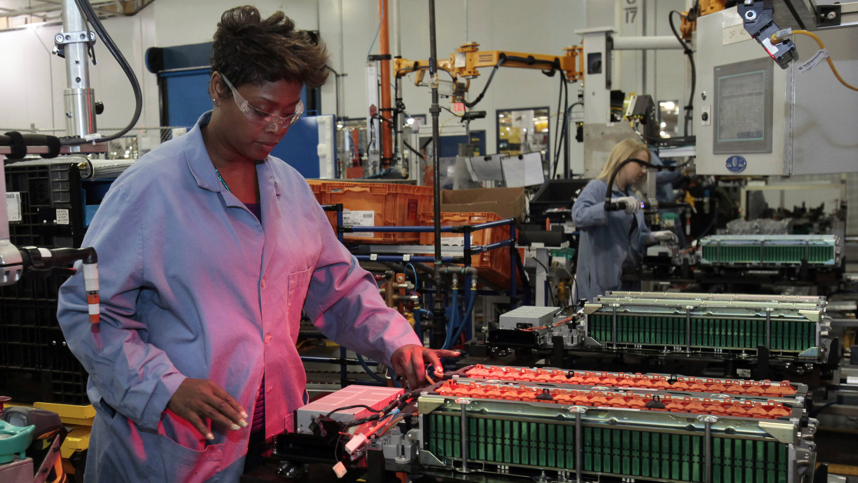 Woman working at a Ford motor plant.