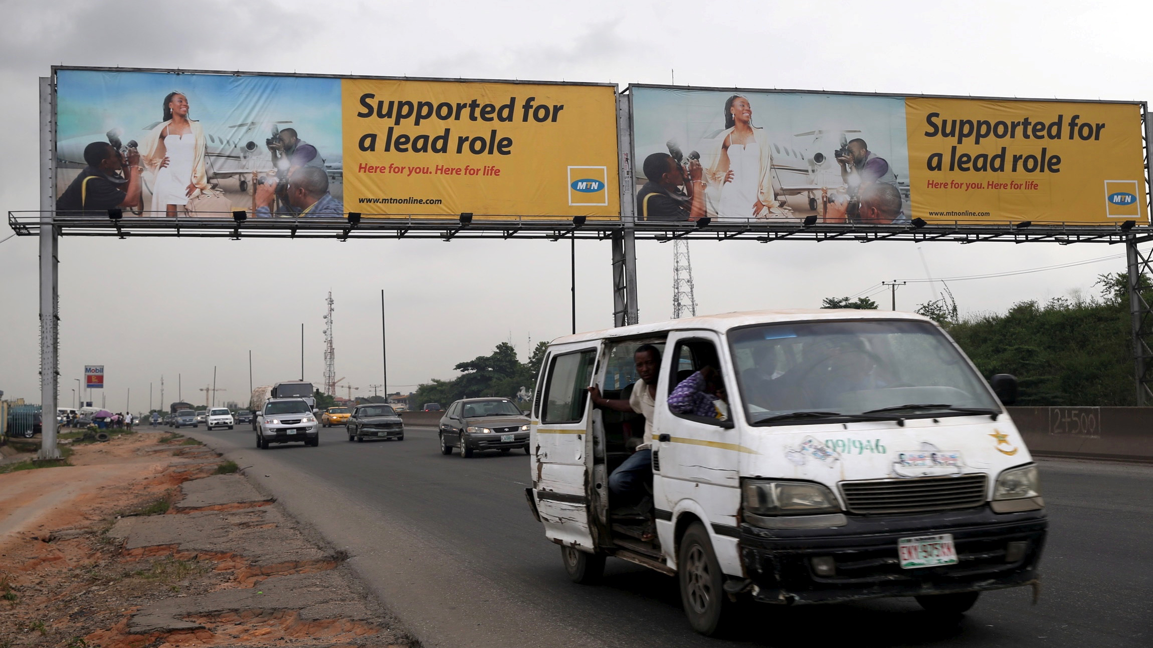 A billboard advertising MTN telecommunication company is seen along a road in Lagos November 16, 2015.   REUTERS/Akintunde Akinleye/File Photo - RTSGX03