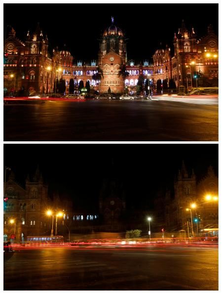 A combination picture shows the Chhatrapati Shivaji Terminus (CST), formerly known as Victoria Terminus, before (top) and after the lights were turned off for Earth Hour in Mumbai, India, March 25, 2017.