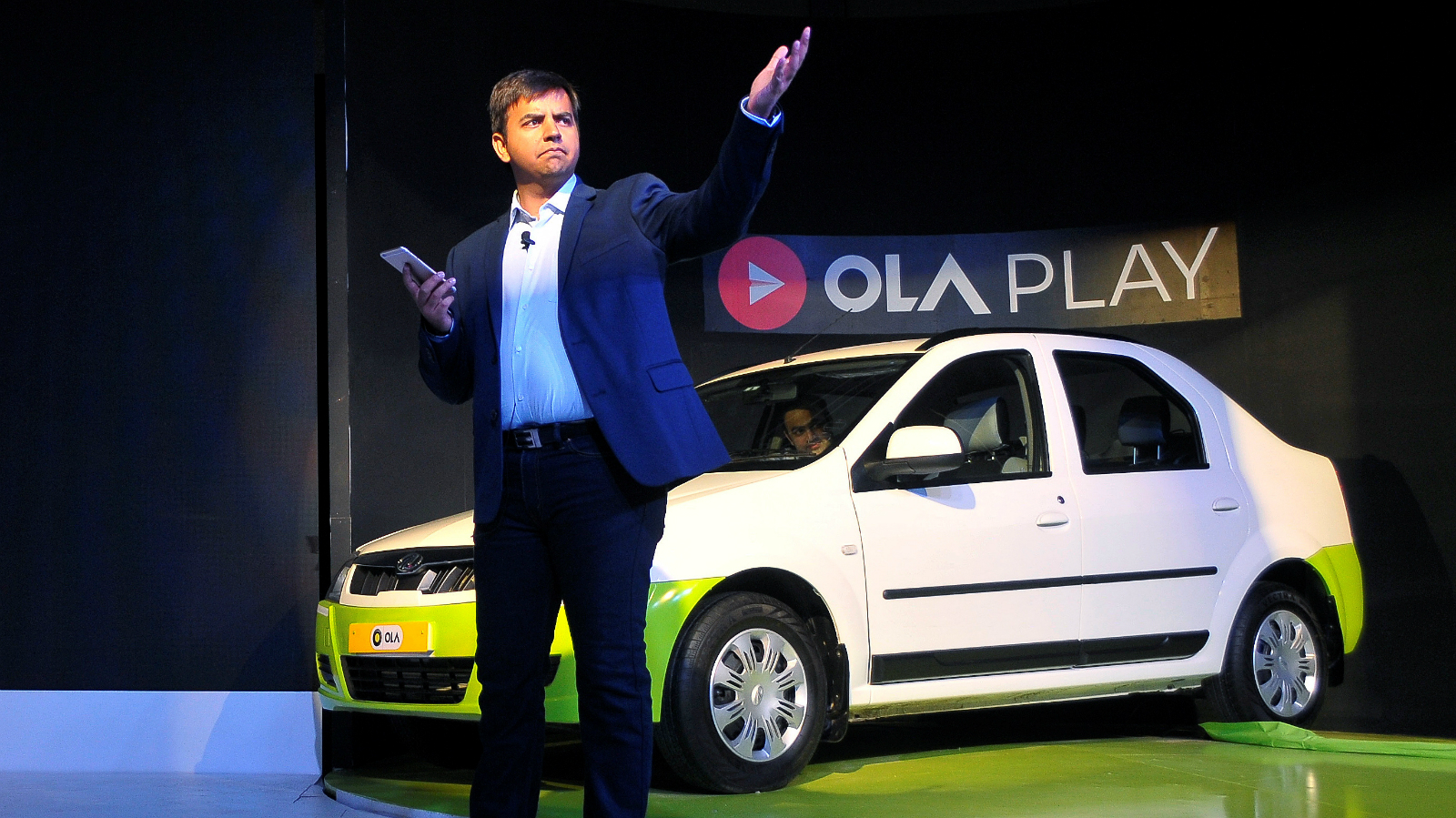 Bhavish Aggarwal, CEO and co-founder of Ola, gestures as he addresses the media during a news conference in Bengaluru, India, November 22, 2016.
