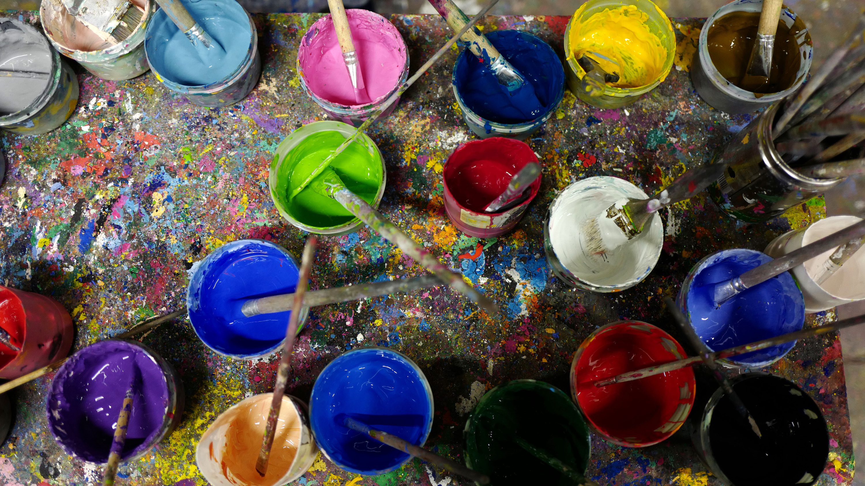 Paint in different colors are seen on a table at an art class for children in the city of Hanau near Frankfurt, Germany, March 7, 2016.
