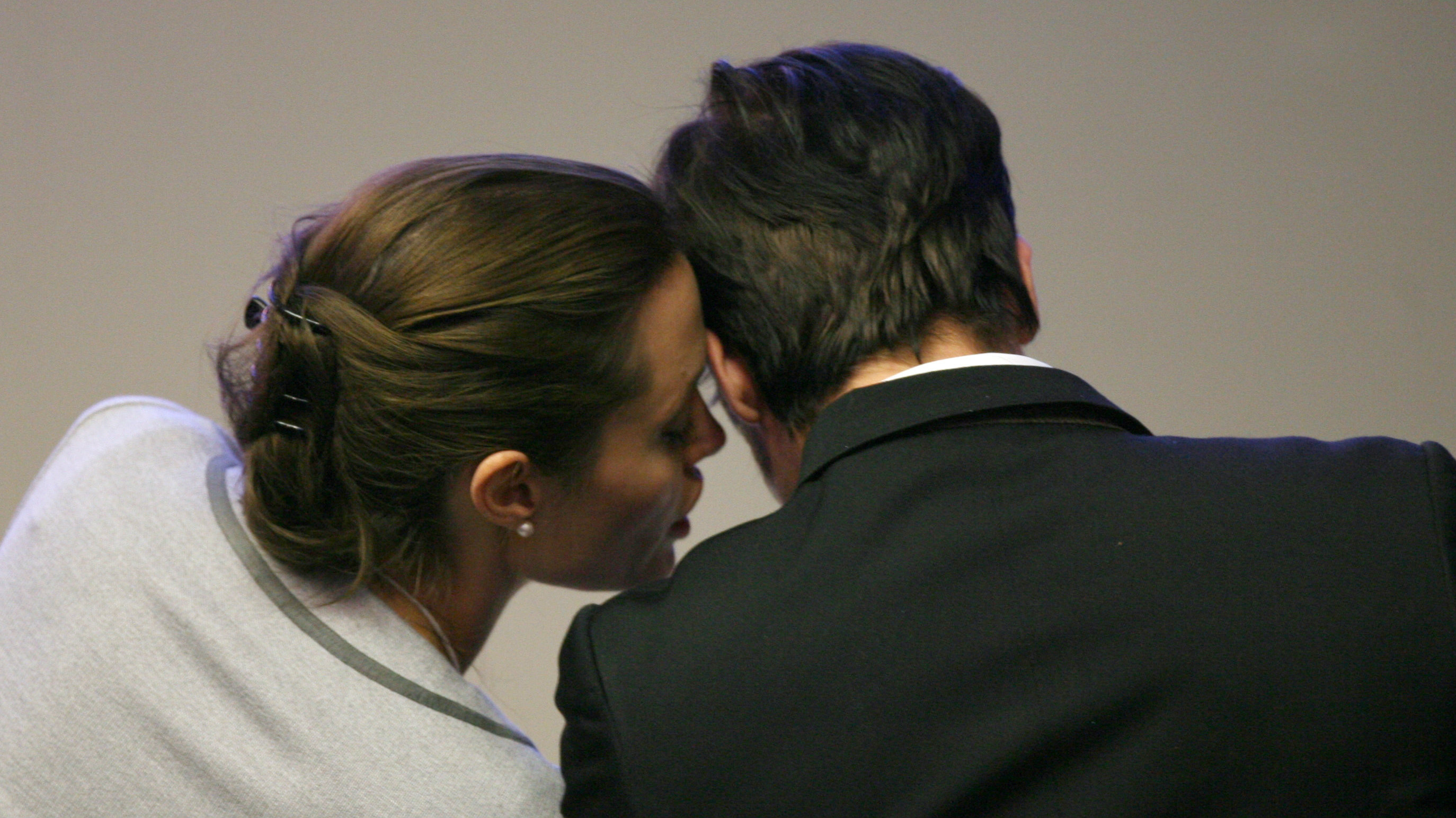 United Nations High Commissioner for Refugees (UNHCR) Goodwill Ambassador U.S. actress Angelina Jolie (L) whispers to U.S. actor Brad Pitt (R) during the 'A New Mindset for the UN' session at the World Economic Forum (WEF) in Davos, Switzerland, January 26, 2006. REUTERS/Pascal Lauener