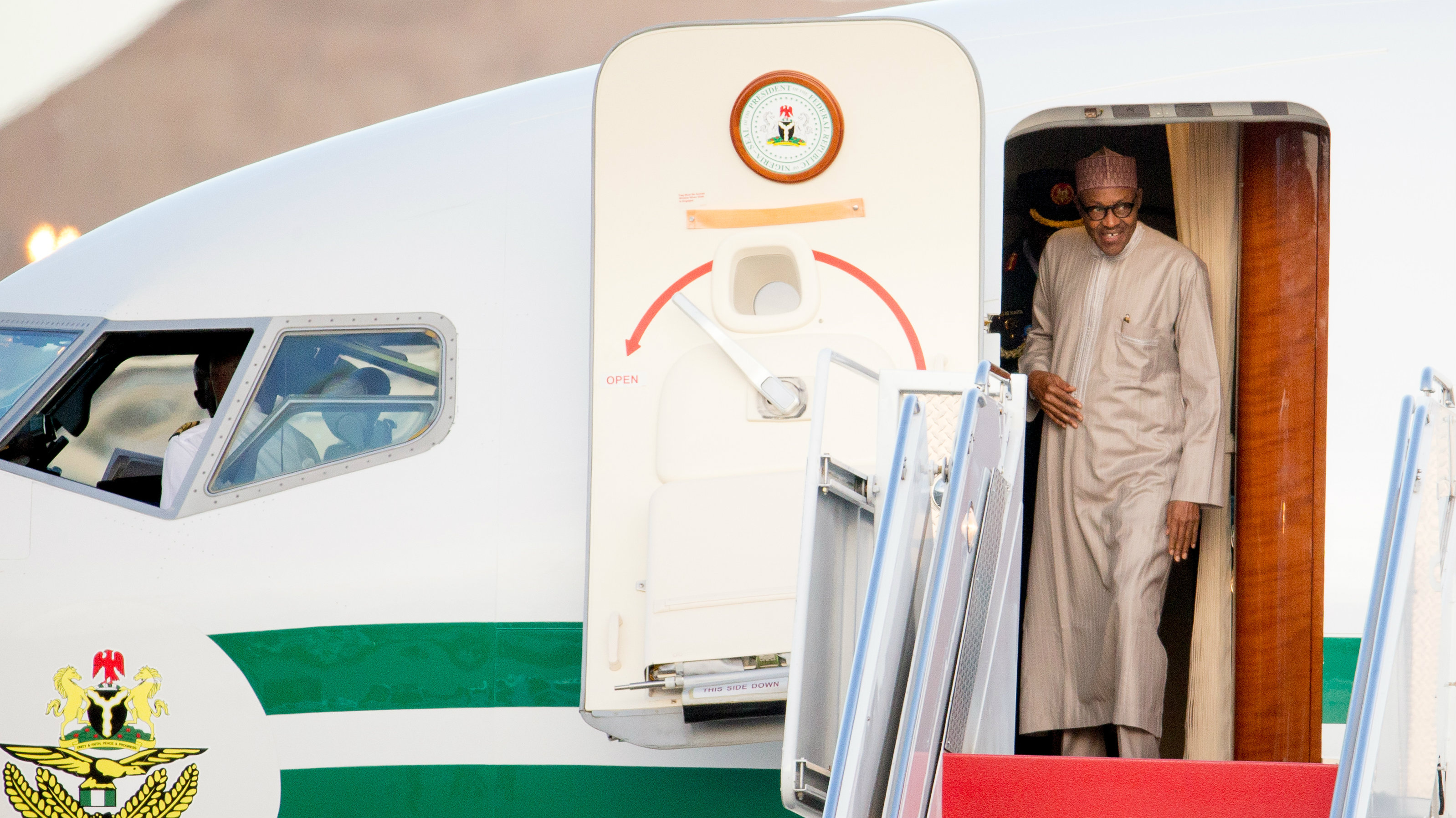 Nigerian President Muhammadu Buhari arrives at Andrews Air Force Base, Md., Wednesday, March 30, 2016. Buhari is in Washington to attend the Nuclear Security Summit.
