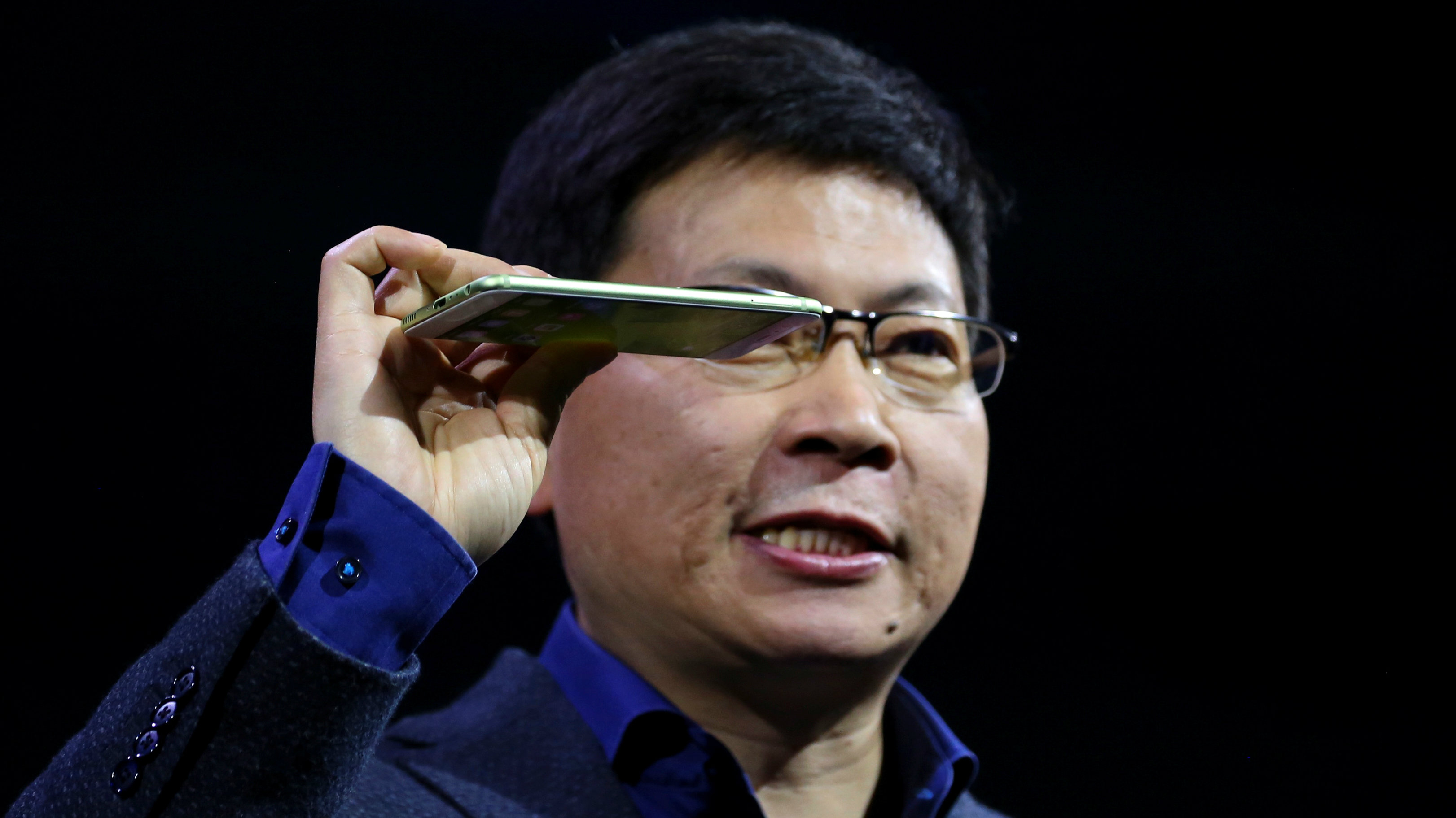 Richard Yu, chief executive of Huawei's consumer business, holds up the new P10 Plus device during a presentation ceremony at Mobile World Congress in Barcelona, Spain, February 26, 2017