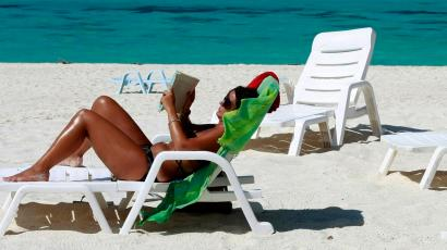 A tourist reads a book in Turatao Marine National Park off the Andaman Sea in southern Thailand's Satun province