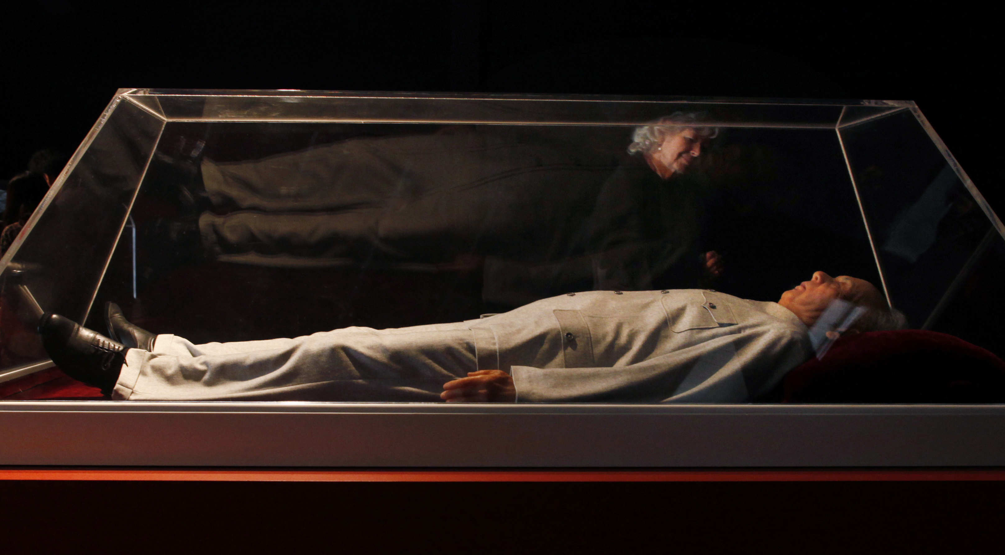 Visitor views a life sized model of a dead Mao Zedong which is part of an installation by Chinese artist Shen Shaomin titled at the 17th Biennale of Sydney