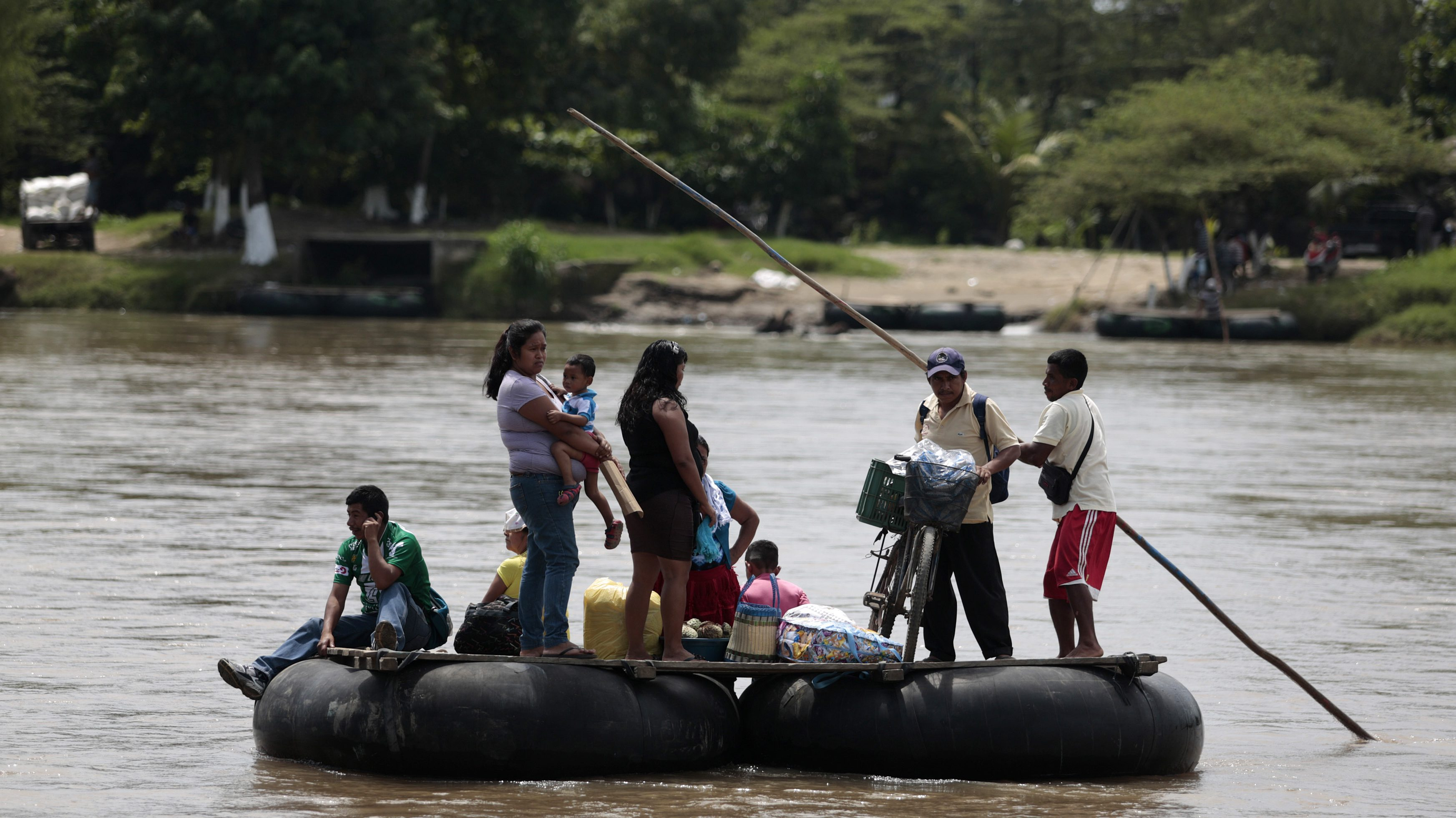 A raft with people from Guatemala, bound for Mexico in the Suchiate river