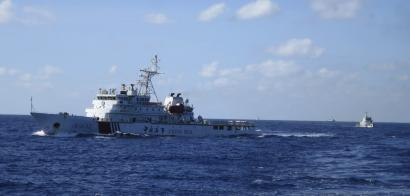 Chinese coastguard ships give chase to Vietnamese coastguard vessels (not pictured) after they came within 10 nautical miles of the Haiyang Shiyou 981, known in Vietnam as HD-981, oil rig in the South China Sea July 15, 2014. Crewmen in blue camouflage uniforms pour out onto the deck of a Vietnamese coastguard ship as an imposing Chinese vessel guarding a giant oil rig gives chase, gathering steam by the second. A group of Chinese ships joined the pursuit, peeling away from a flotilla of about two-dozen vessels surrounding HD-981, the $1 billion rig that China deployed without notice in early May, triggering the worst breakdown in ties between the communist neighbours in three decades. Vietnam says this stretch of the South China Sea is in its 200-nautical mile exclusive economic zone and accuses China of bullying and trying to ram Vietnamese fishing vessels in the potentially energy-rich waters. China claims about nine-tenths of the South China Sea but insists it wants a peaceful resolution to the conflict. Picture taken July 15, 2014.