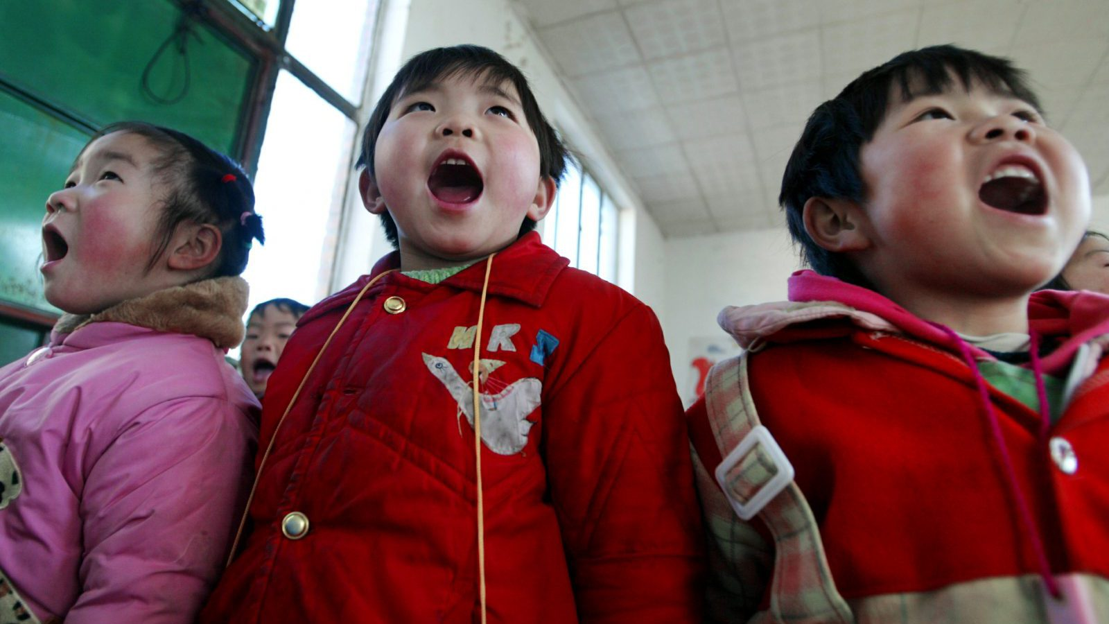 Chinese children sing during a lesson in Xingzhi School which teaches more than 1,200 children of rural immigrants in Beijing.  Chinese children sing during a lesson in Xingzhi School which teaches more than 1,200 children of rural immigrants in Beijing March 2, 2005. By the end of 2004, 93.6 percent of Chinese children were receiving nine years of compulsory education, China's official news agency Xinhua reported.