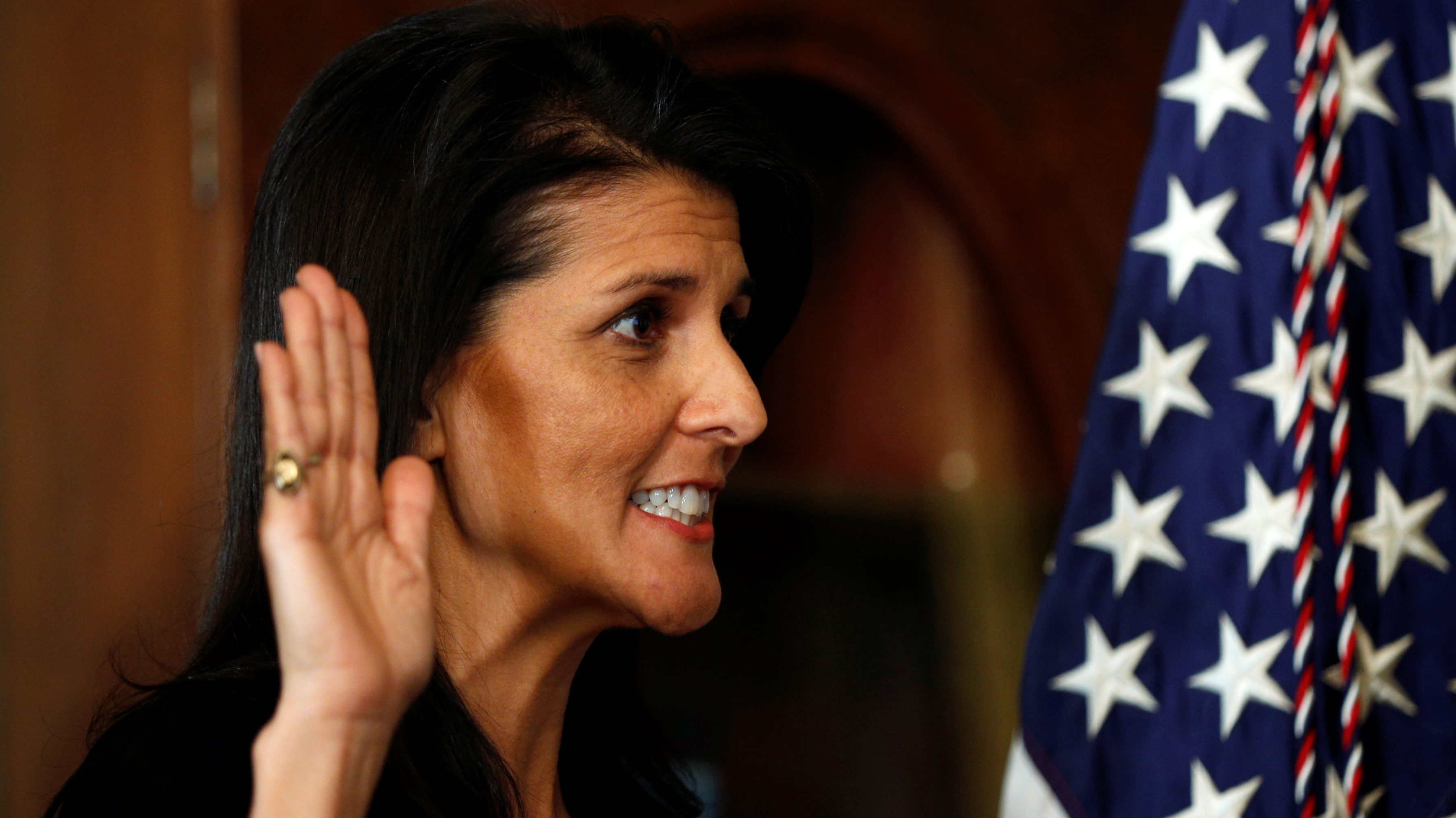 Nikki Haley is sworn in as U.S. Ambassador the the United Nations by U.S. Vice President Mike Pence in the Eisenhower Executive Office Building in Washington, U.S., January 25, 2017.  REUTERS/Kevin Lamarque - RTSXBJ7