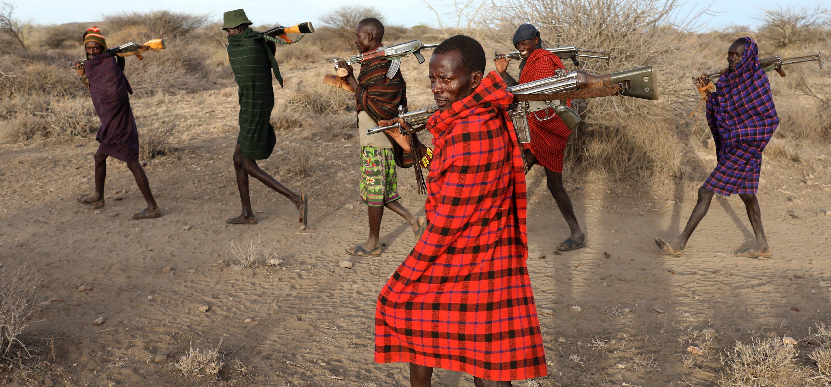 Turkana tribesmen walk with guns in order to protect their cattle from rival Pokot and Samburu tribesmen near Baragoy, Kenya February 14, 2017.