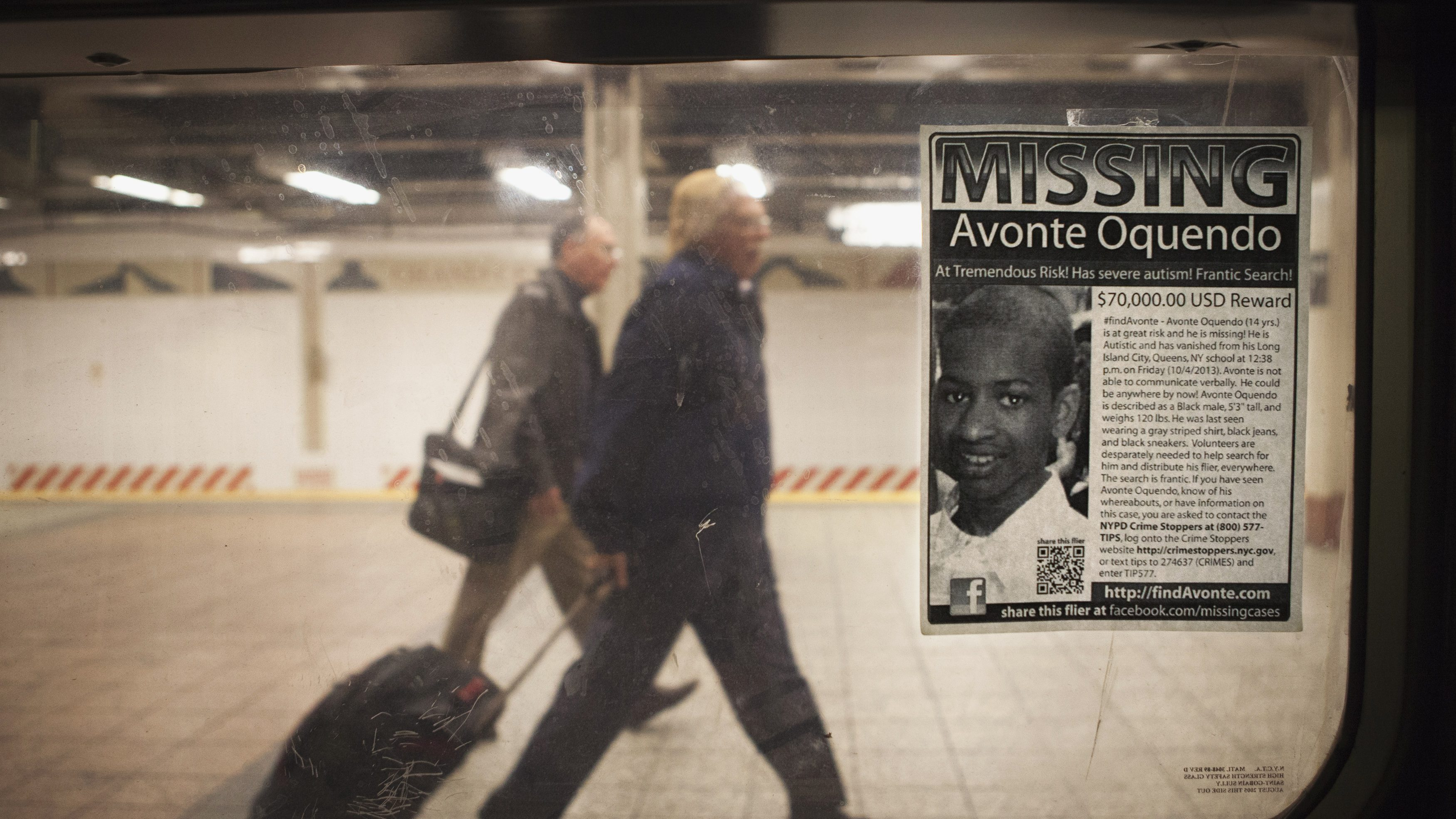 "A missing poster for Avonte Oquendo, a 14-year-old autistic boy who has been missing for 3 weeks since walking out of his school, is posted on a subway window in the Times Square station of New York, October 25, 2013. New York Police commissioner Ray Kelly has been quoted in local media saying ""Unfortunately, we are not hopeful that we're going to find this young man alive, but we are continuing our search.""   REUTERS/Carlo Allegri  (UNITED STATES - Tags: SOCIETY TRANSPORT) - RTX14OBU"