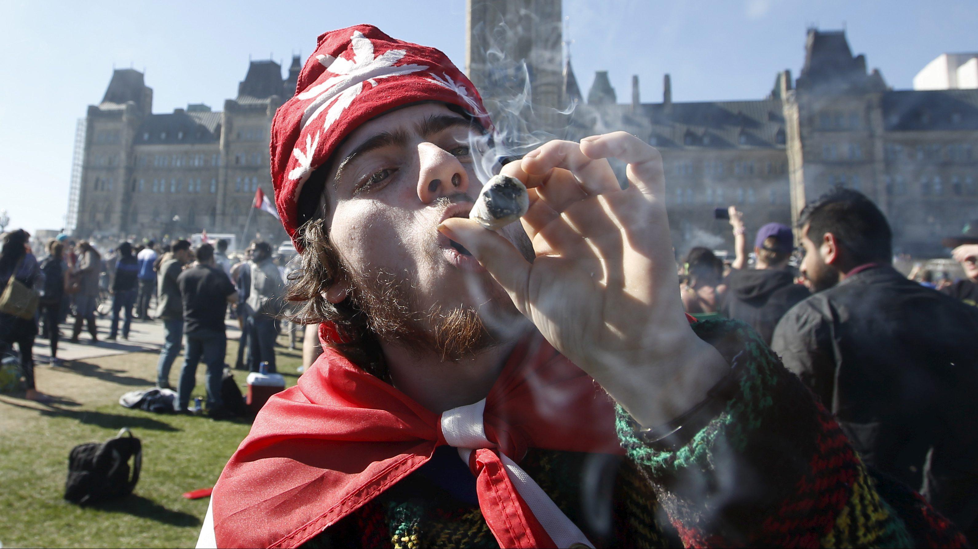 A man smokes marijuana on Parliament Hill in Ottawa
