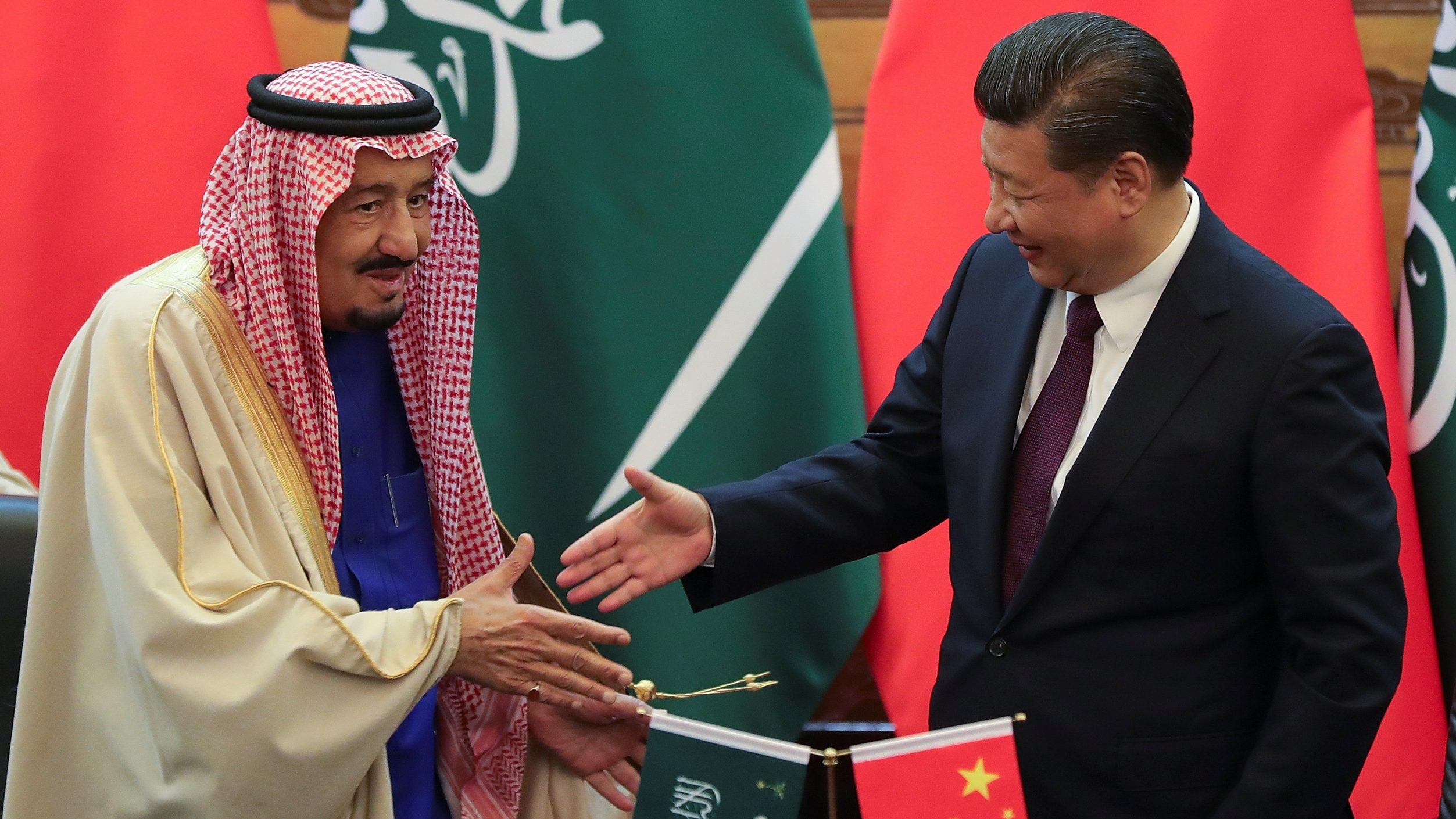 China's President Xi Jinping (R) and Saudi Arabia's King Salman bin Abdulaziz Al-Saud shake hands during a signing ceremony at the Great Hall of the People in Beijing, China March 16, 2017.