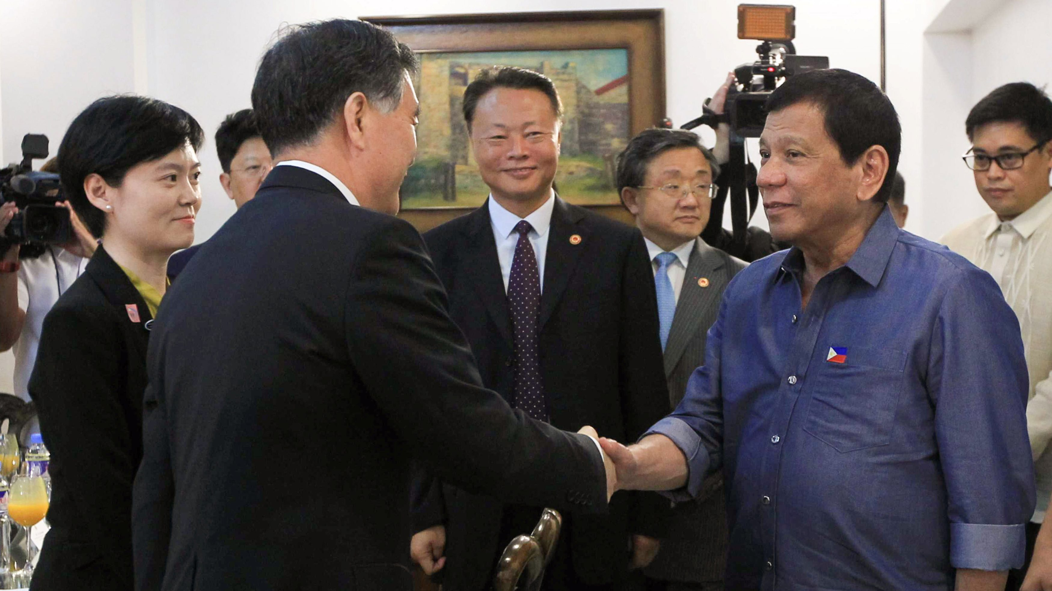 Philippine President Rodrigo Duterte greets Vice Premier of China, Wang Yang (L) during his courtesy call at the Presidential Guest House in Davao city, Philippines March 17, 2017.