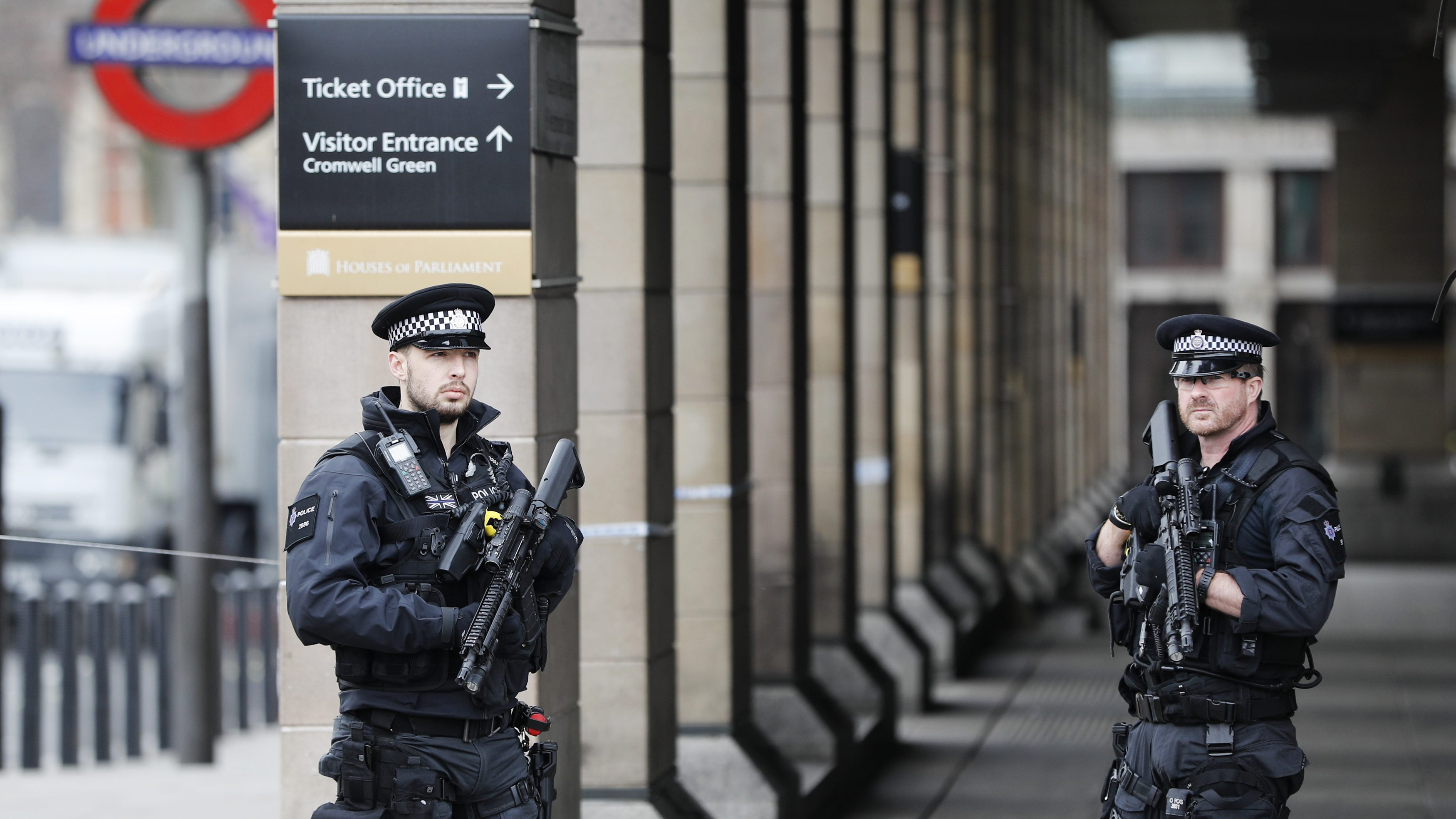 Armed police officers patrol outside Westminster underground station the morning after an attack in London