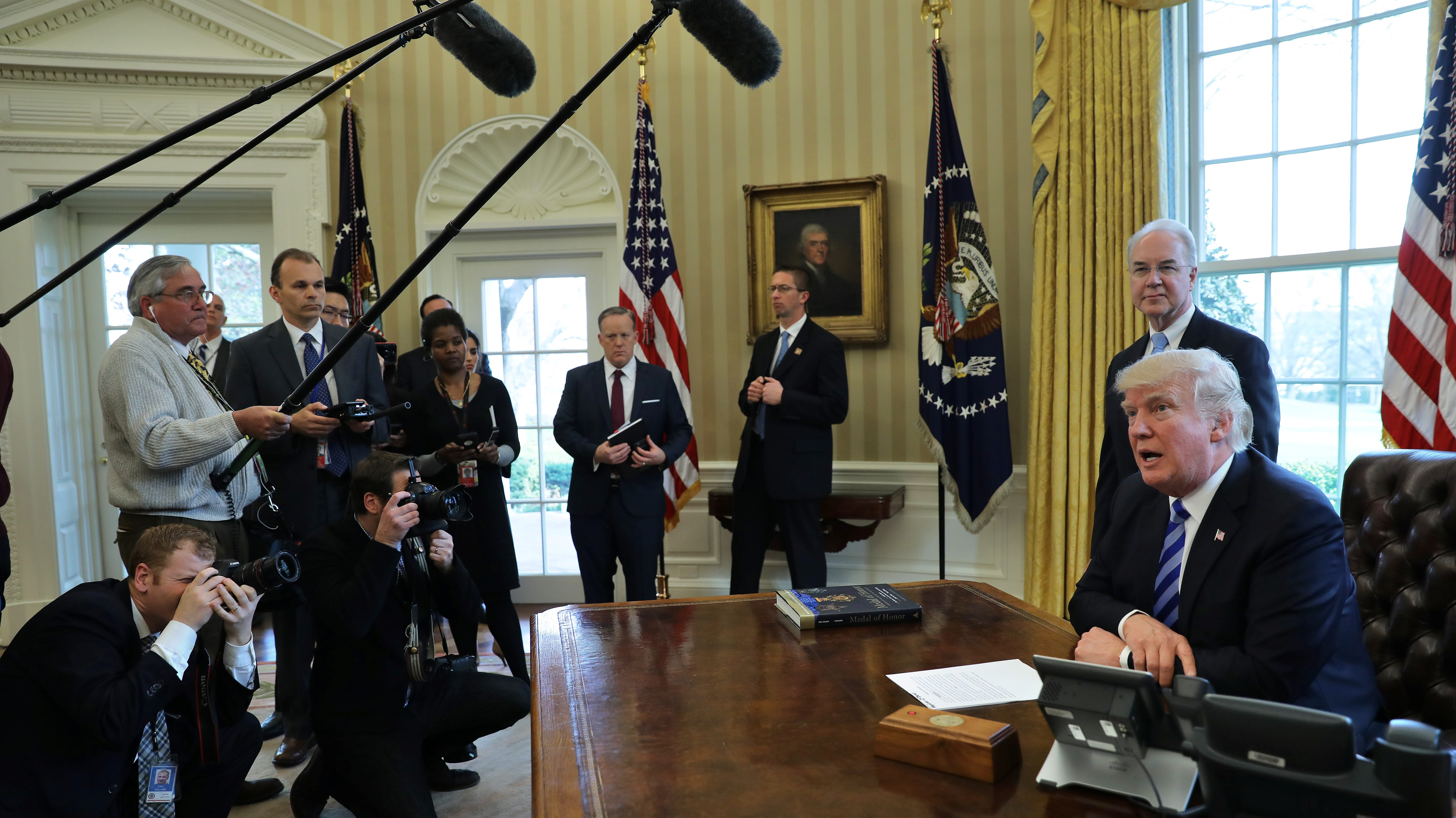 U.S. President Donald Trump talks to journalists at the Oval Office of the White House after the AHCA health care bill was pulled before a vote, accompanied by U.S. Health and Human Services Secretary Tom Price (2nd R) and Vice President Mike Pence (not pictured), in Washington, U.S., March 24.