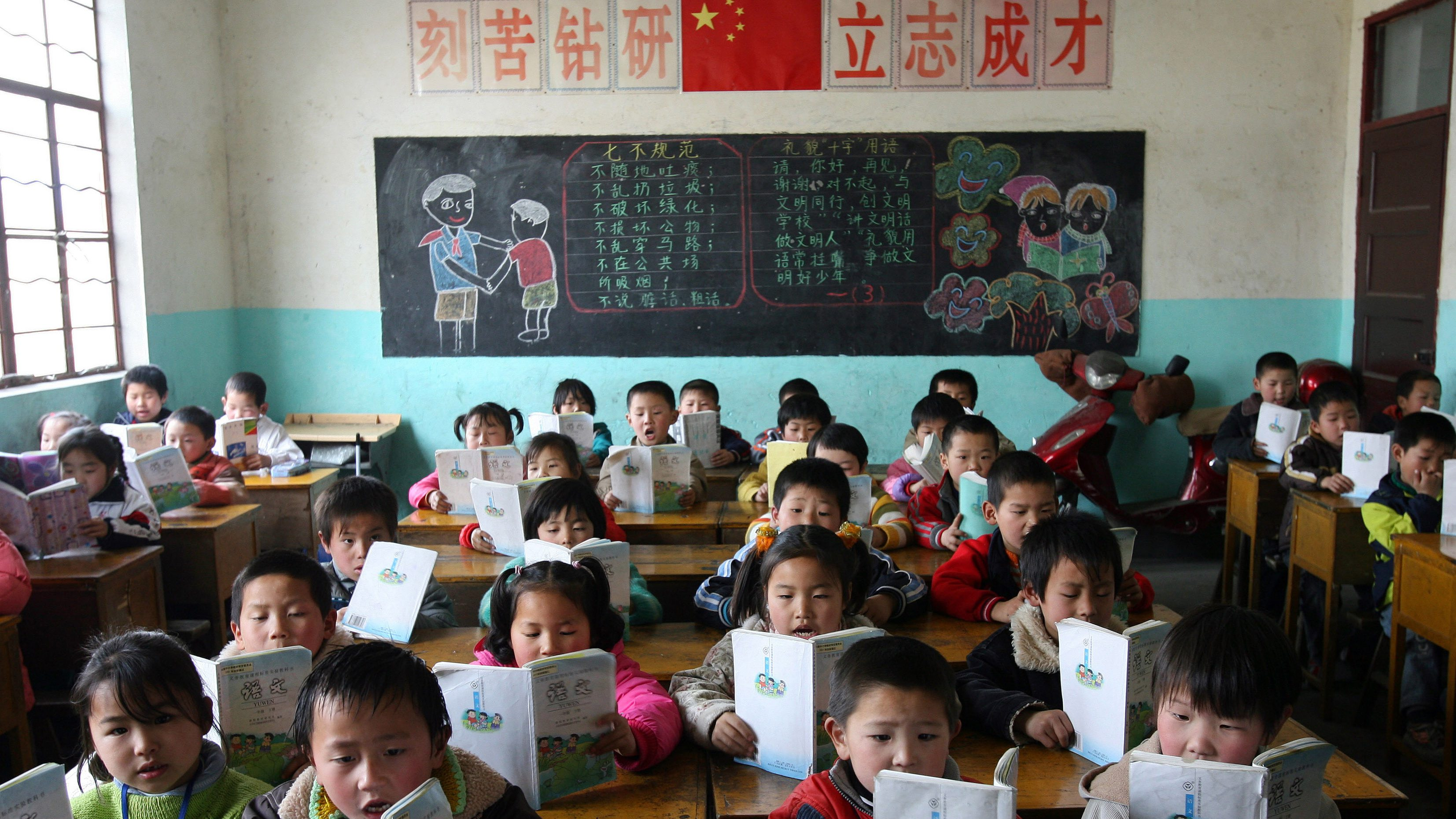 Chinese immigrant workers' children study in their classroom in a rural part of Shanghai March 6, 2006. [Premier Wen Jiabao] told parliament on Sunday that China would channel its surging economic growth to improve living conditions of rural people and narrow the widening gap between the country's rich cities and restive countryside. - RTXOD2E