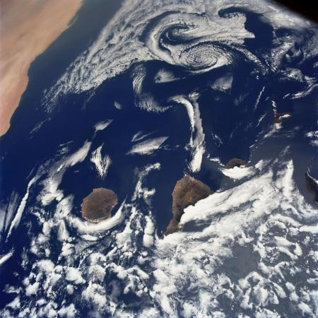 The Canary Islands, just west of Africa, are pictured under a swirl of clouds in 1991.
