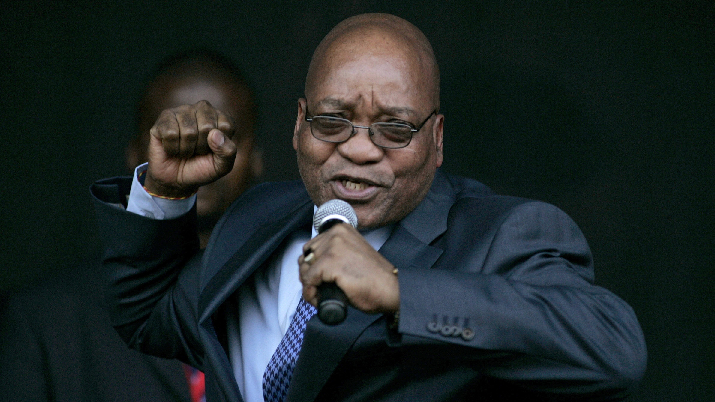 Jacob Zuma, leader of South Africa's ruling African National Congress (ANC), sings for his supporters at the Pietermaritzburg high court outside Durban August 4, 2008. Zuma appeared in court on Monday to push for the dismissal of a corruption case that could stop him becoming president next year. Over 1,000 supporters demonstrated outside the high court in Pietermaritzburg to denounce charges they say are politically motivated and to try to stop Zuma from being put on trial later in the year. REUTERS/Siphiwe Sibeko (SOUTH AFRICA) - RTR20MBW